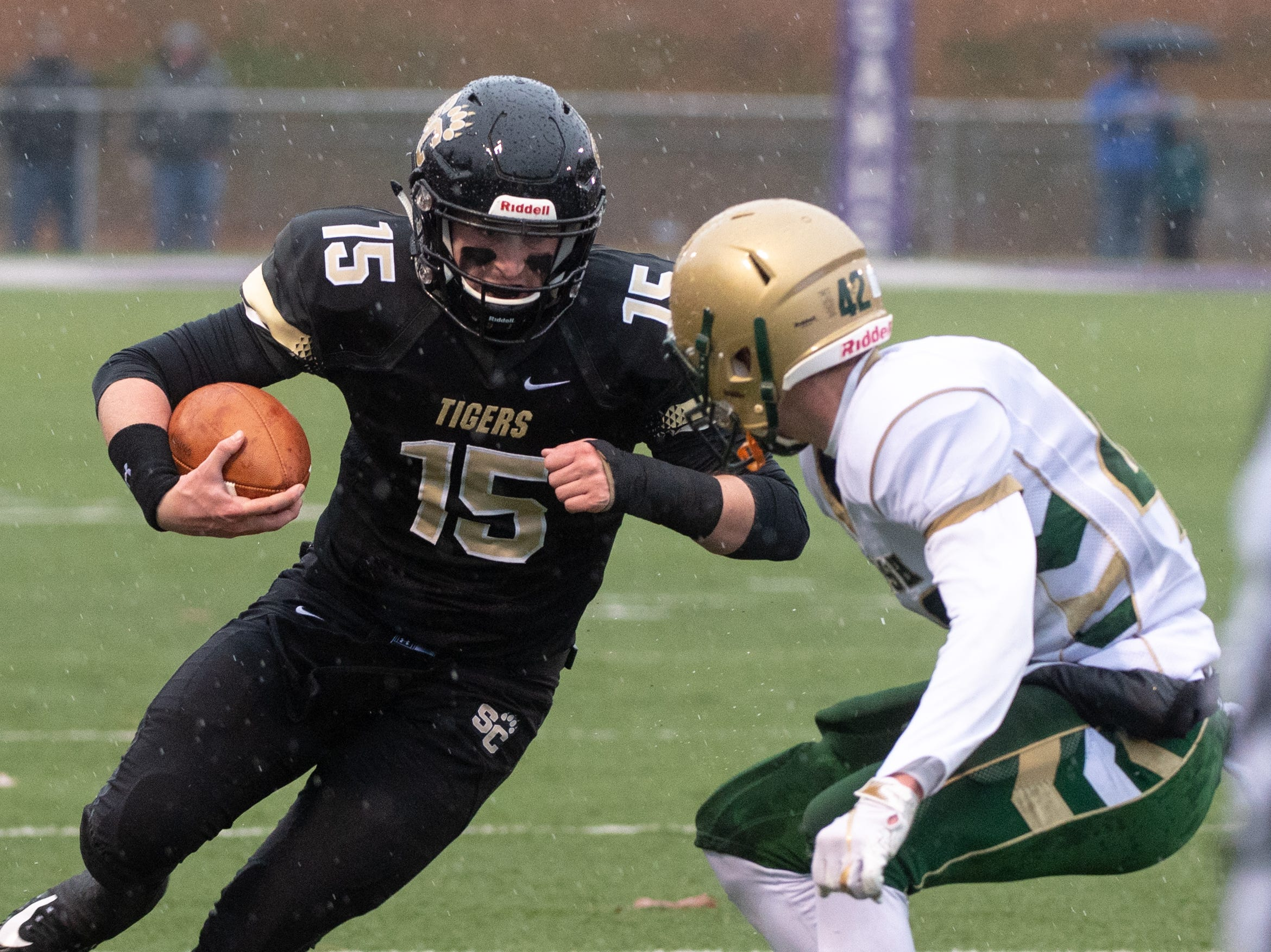 Stone Hollenbach (15) runs for the first down during the state quarter-finals game between York Catholic and Southern Columbia at Shamokin Area High School, November 24, 2018. The Tigers defeated the Irish 56-23.