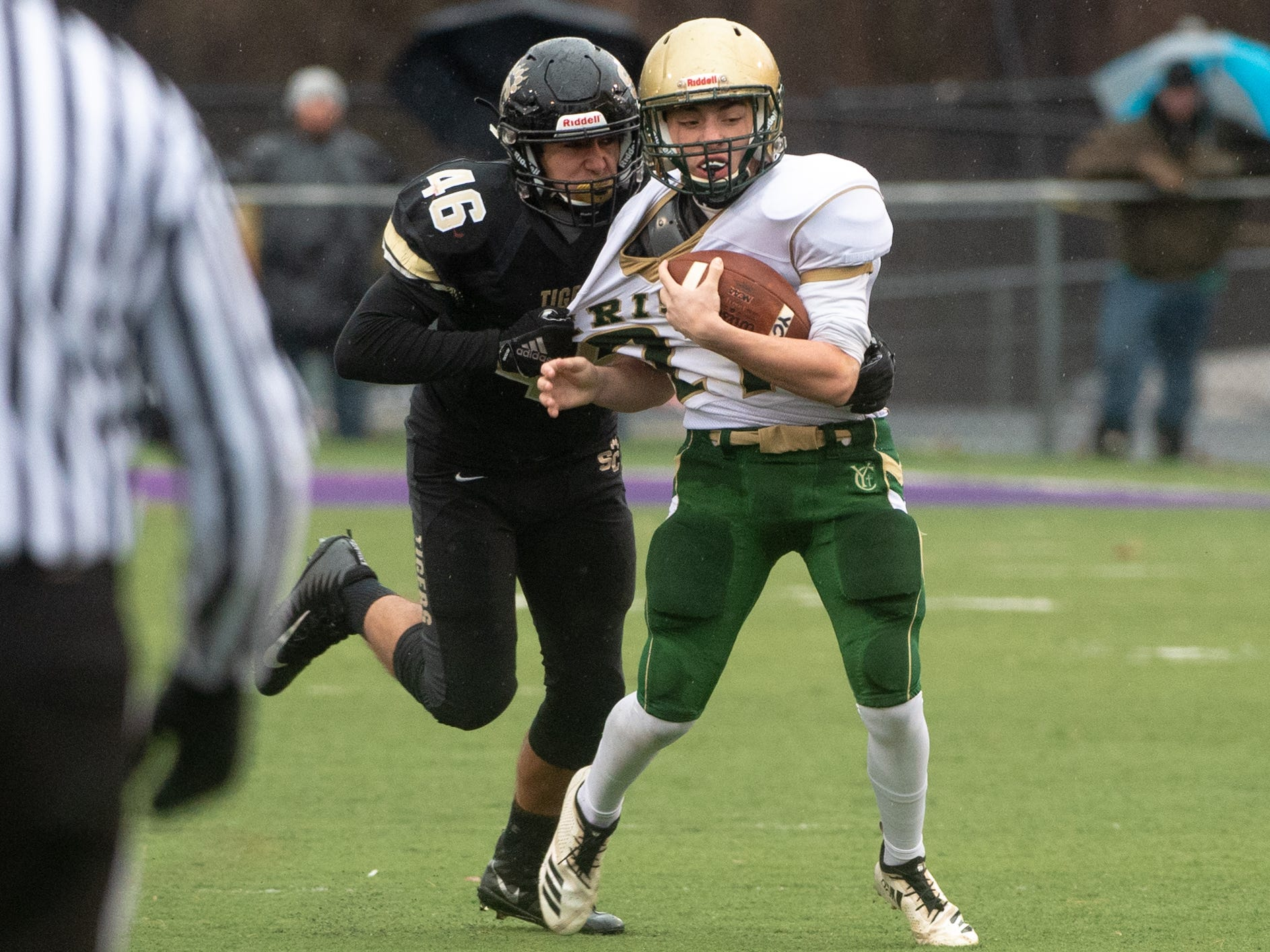 Wade Kerstetter (46) of Southern Columbia tries to stop the run during the state quarter-finals game between York Catholic and Southern Columbia at Shamokin Area High School, November 24, 2018. The Tigers defeated the Irish 56-23.