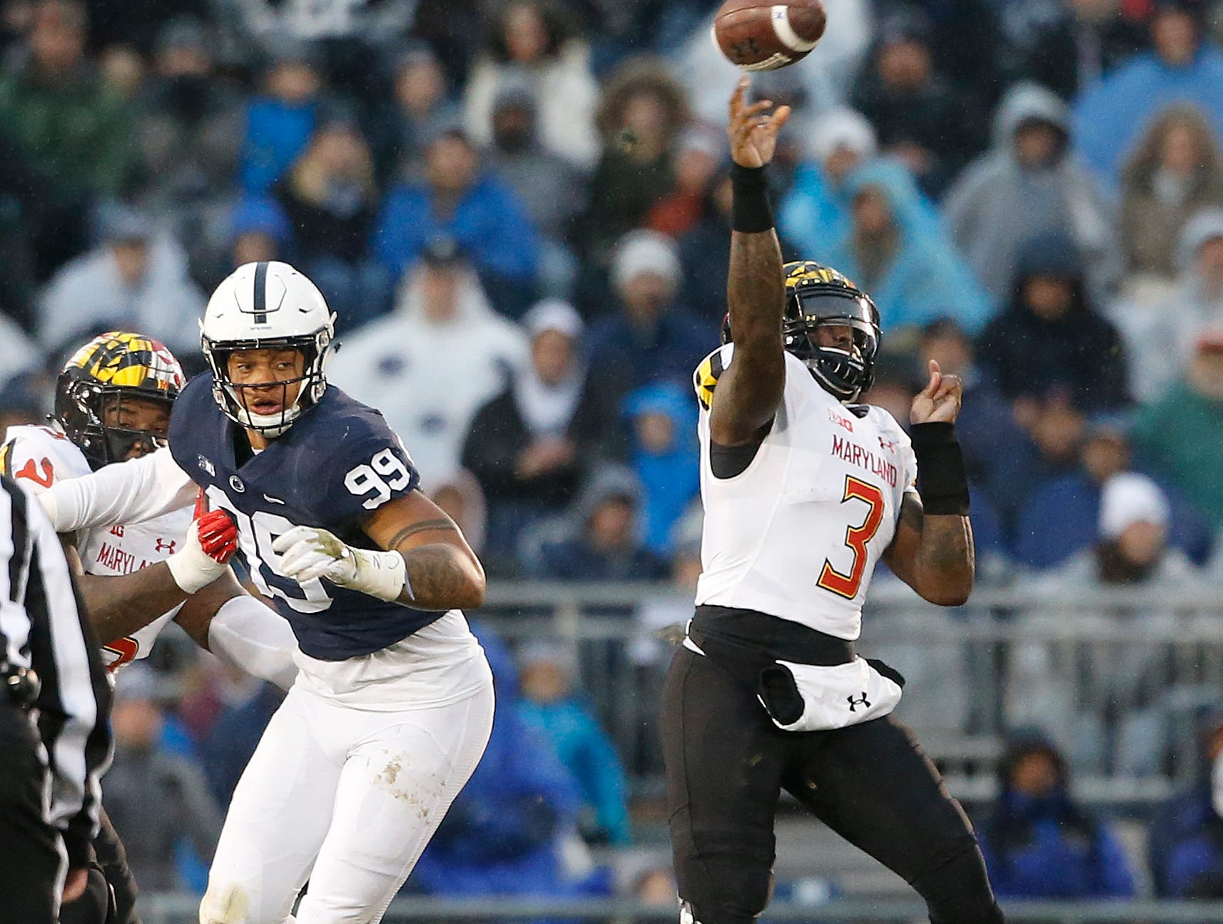Maryland quarterback Tyrrell Pigrome (3) throws a pass against Penn State during the first half of an NCAA college football game in State College, Pa., Saturday, Nov. 24, 2018.