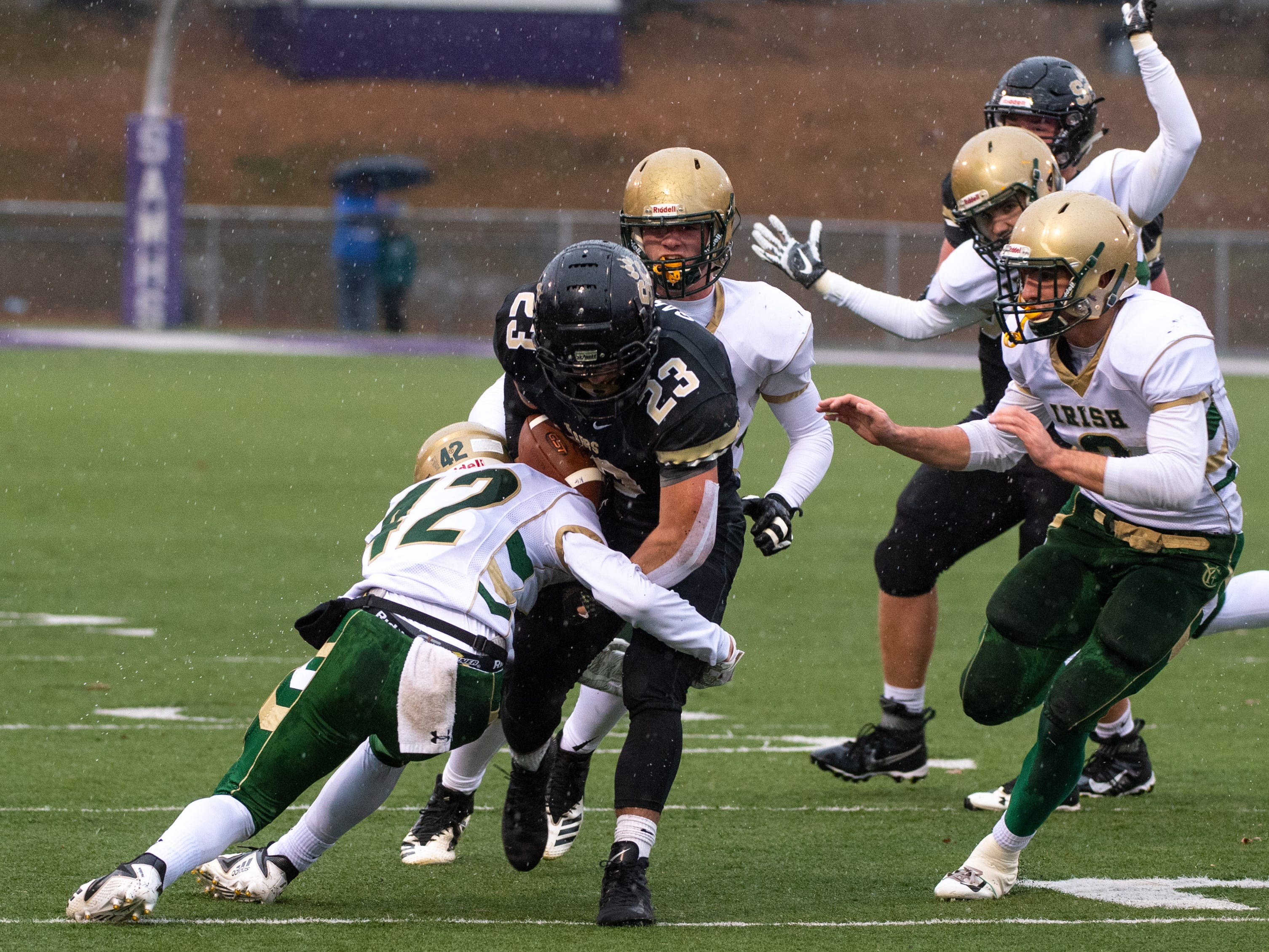 Gaige Garcia (23) is taken down during the state quarter-finals game between York Catholic and Southern Columbia at Shamokin Area High School, November 24, 2018. The Tigers defeated the Irish 56-23.