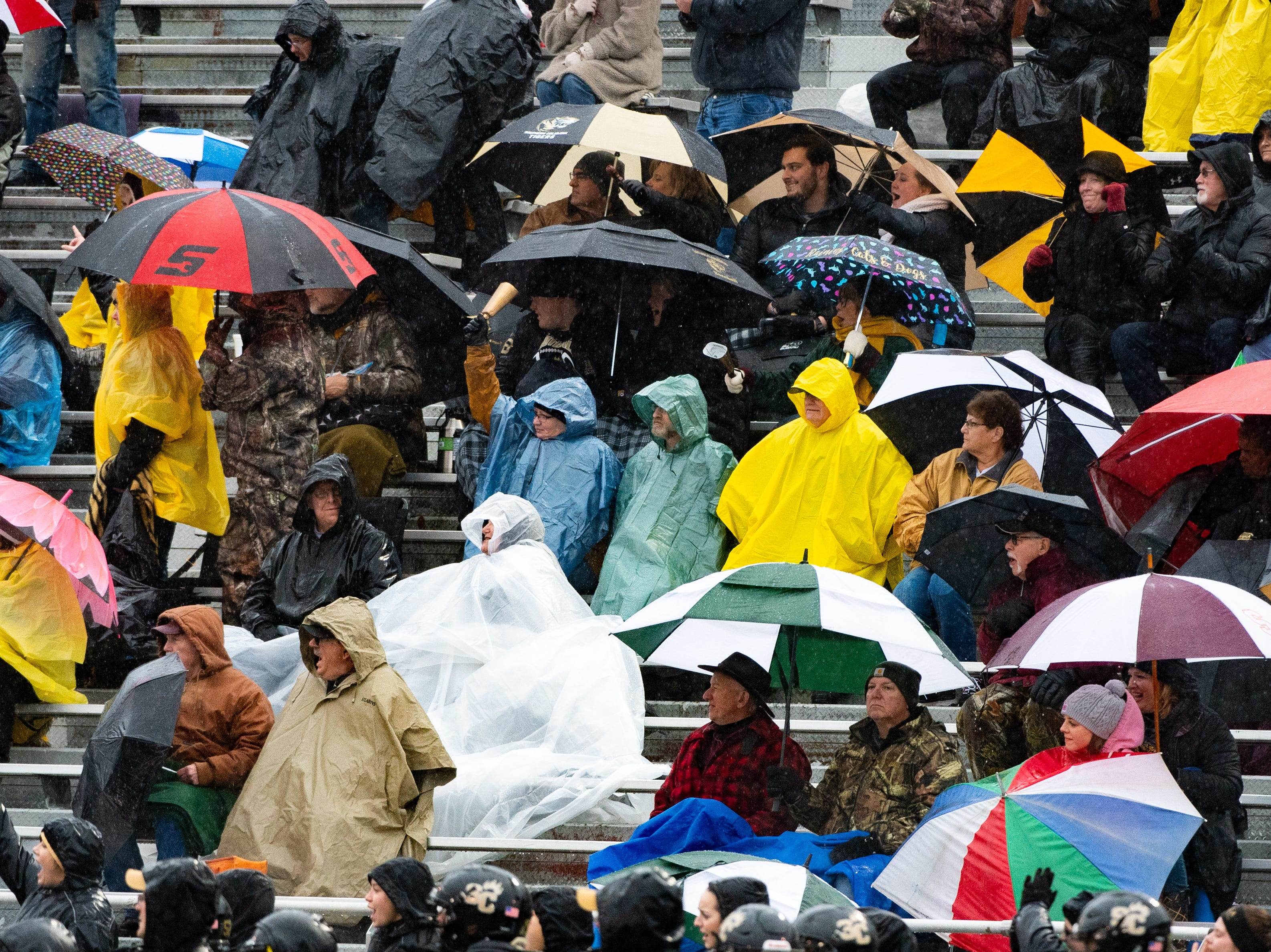 Fans have umbrellas handy as they watch the state quarter-finals game between York Catholic and Southern Columbia at Shamokin Area High School, November 24, 2018. The Tigers defeated the Irish 56-23.