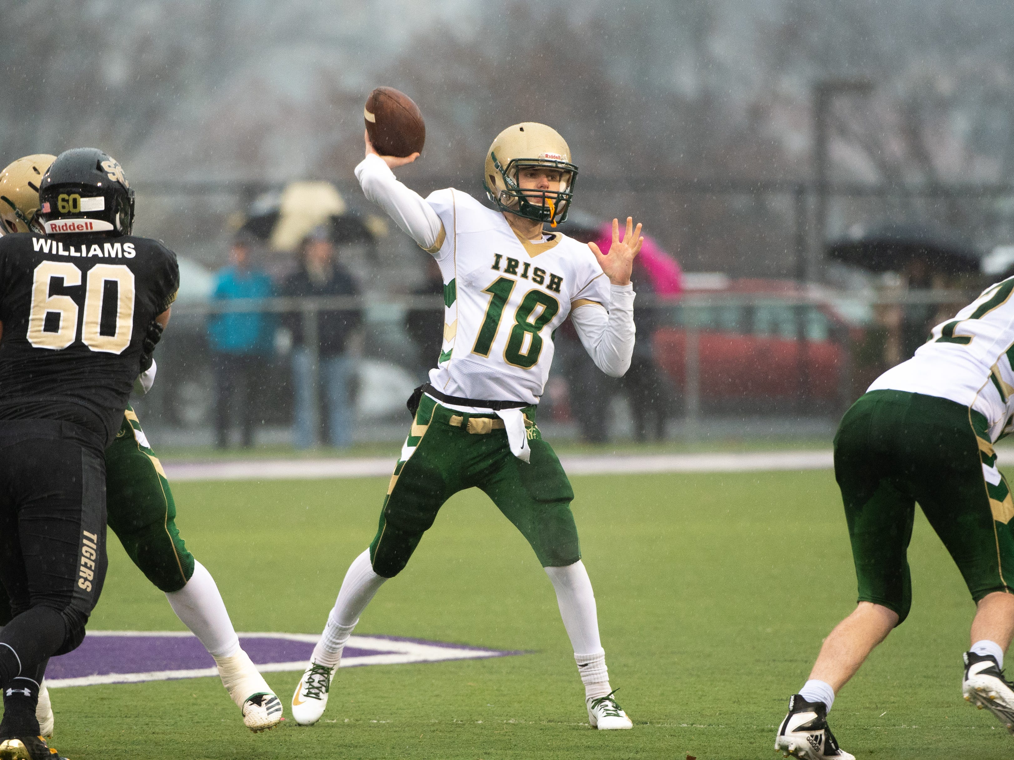 Wesley Burns (18) has room to throw during the state quarter-finals game between York Catholic and Southern Columbia at Shamokin Area High School, November 24, 2018. The Tigers defeated the Irish 56-23.
