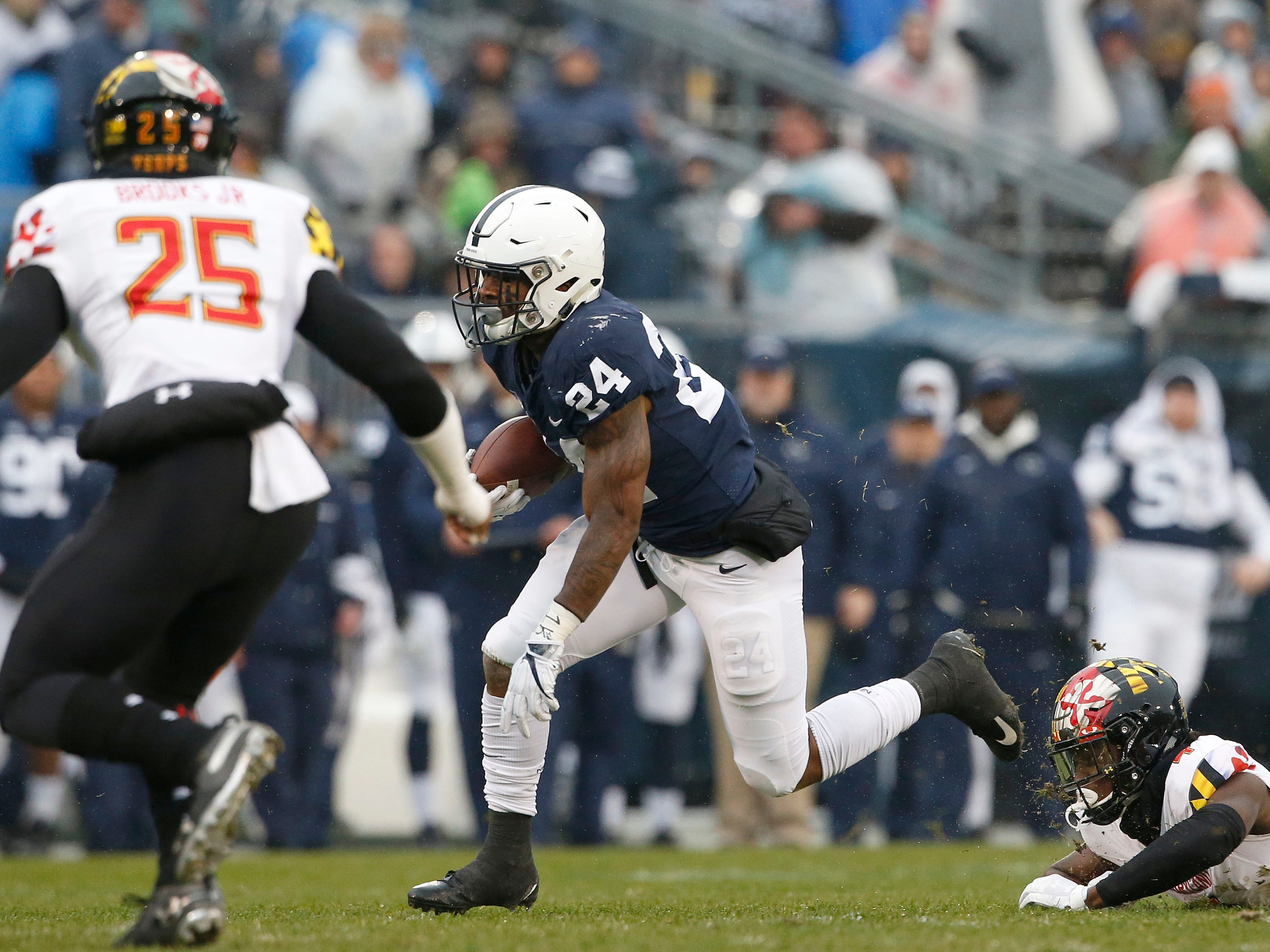 Penn State's Miles Sanders (24) gets past Maryland's Darnell Savage Jr. (4) during the first half of an NCAA college football game in State College, Pa., Saturday, Nov. 24, 2018.