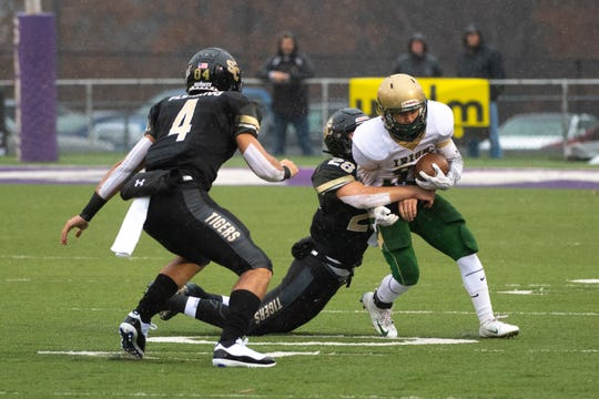 Cal Haladay (28) of Southern Columbia makes the tackle during the state quarter-finals game between York Catholic and Southern Columbia at Shamokin Area High School, November 24, 2018. The Tigers defeated the Irish 56-23.