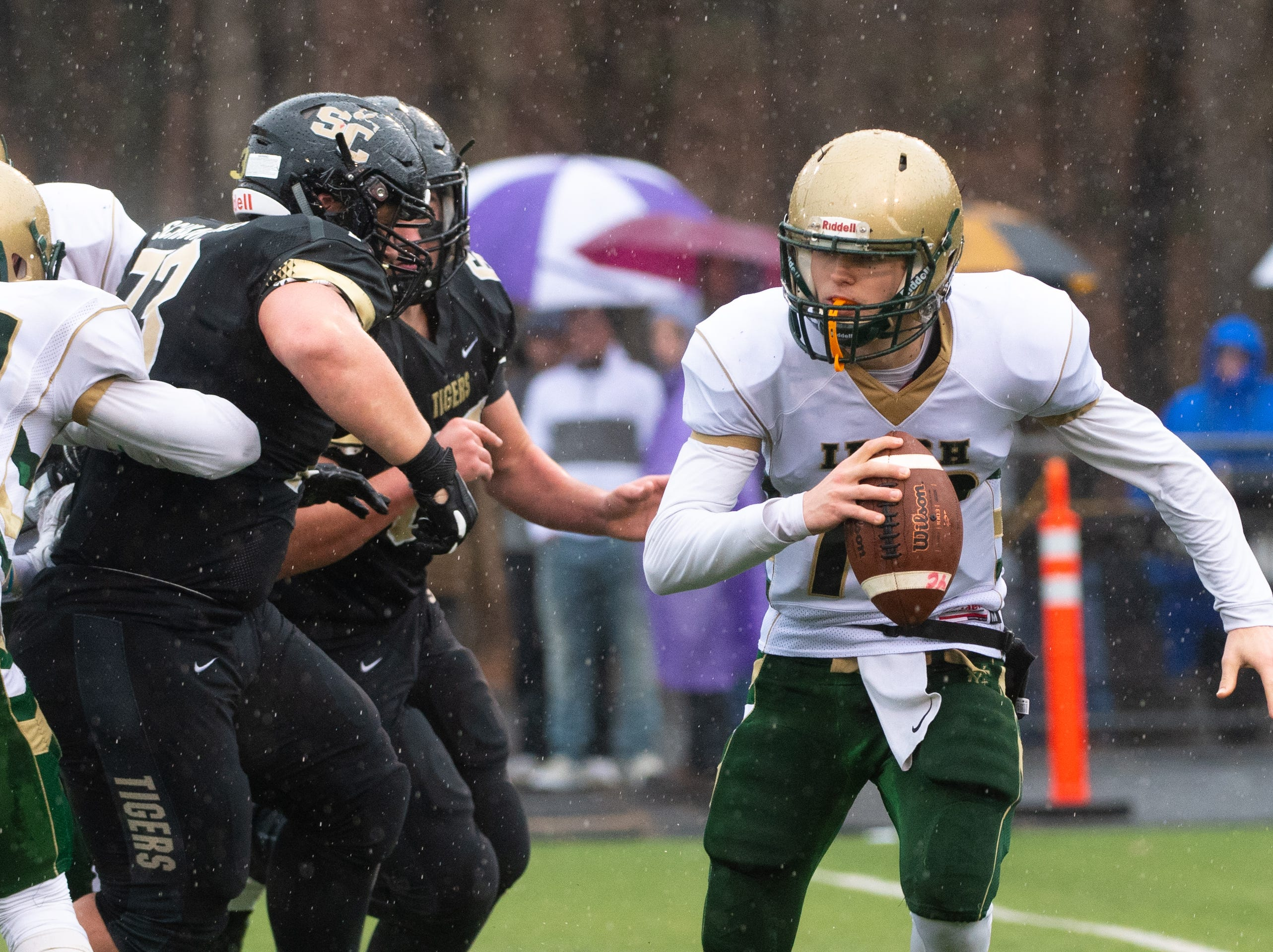 Wesley Burns (18) decides to run the ball himself during the state quarter-finals game between York Catholic and Southern Columbia at Shamokin Area High School, November 24, 2018. The Tigers defeated the Irish 56-23.