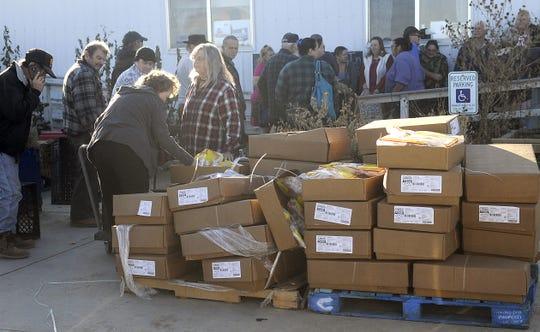 People pick up food at the Silver Springs Food Pantry.