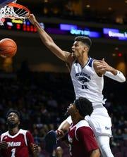 Nevada's Trey Porter dunks over Massachusetts' Luwane Pipkins on Friday night at the Orleans Arena in Las Vegas.