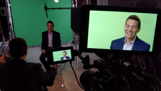 """Film crew behind the scenes shooting """"The Music Makers of Gennett"""" interview musician Michael Feinstein."""