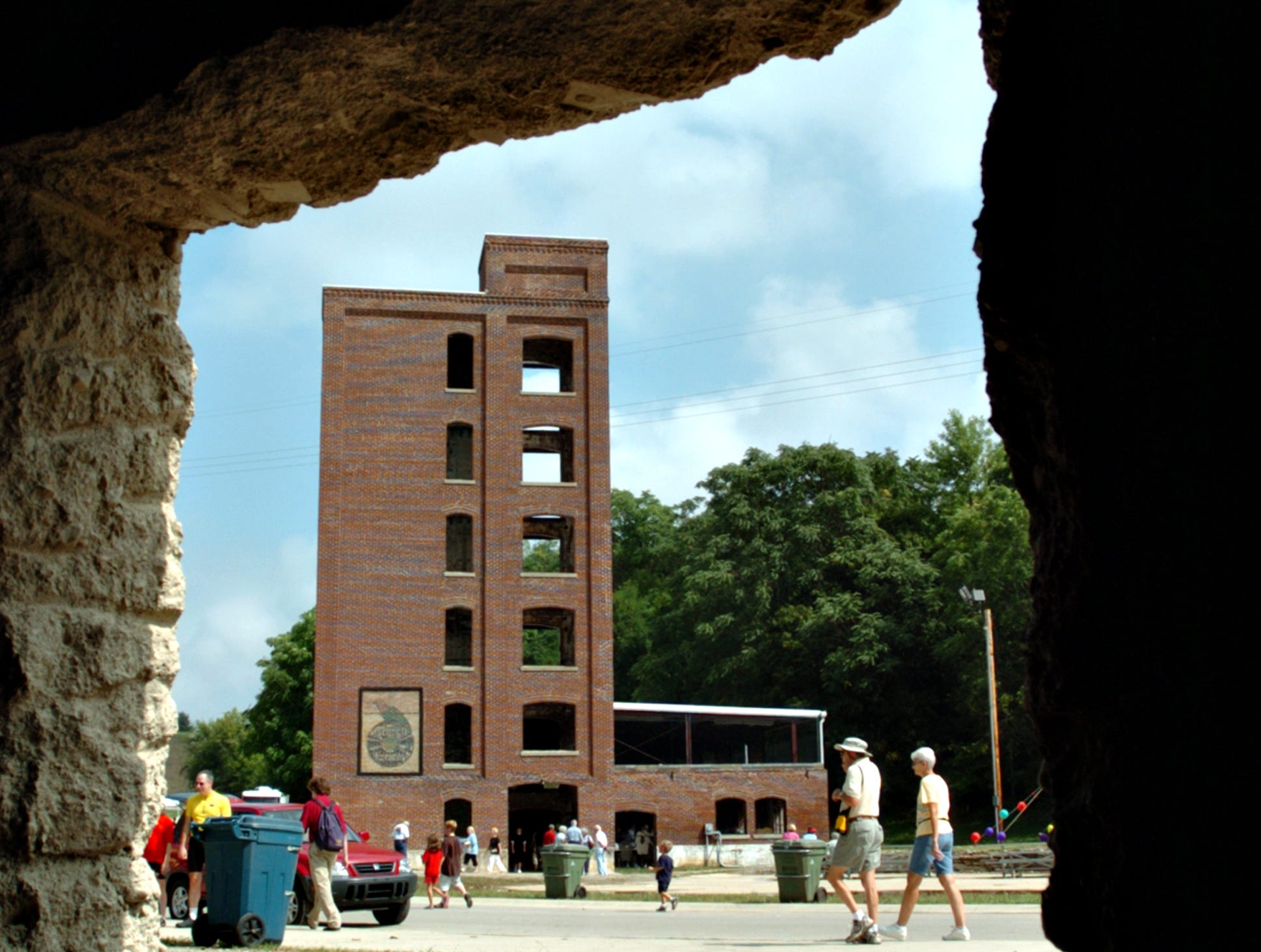 The Starr-Gennett building is framed by an opening of another building during the Starr-Gennett Walk of Fame celebration in the Whitewater Valley Gorge Park Saturday, Sept. 8, 2007.