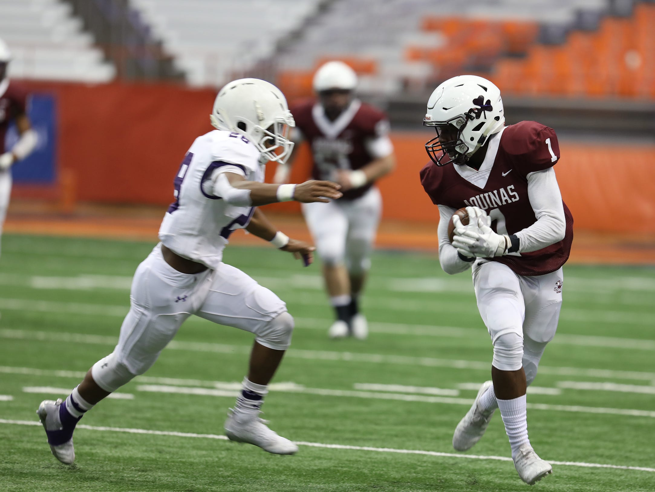 New Rochelle's Colin Jennings starts to catch up to Aquinas' Ulysees Russell.
