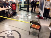 Materials used to treat at least one of the men were scattered on the floor at Pacsun. Police and the mall's management say the dispute began at a Macy's store.