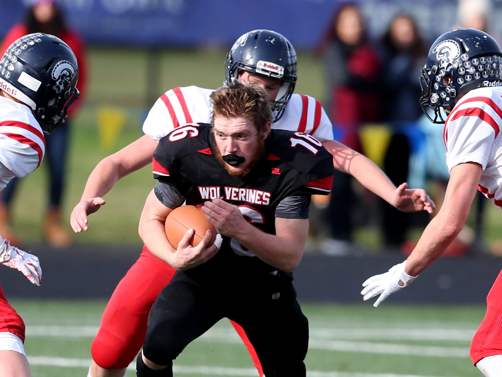 Santiam's Trevor Tinney (16) loses his helmet in the Kennedy vs. Santiam OSAA Class 2A state championship football game at Cottage Grove High School in Cottage Grove on Saturday, Nov. 24, 2018.