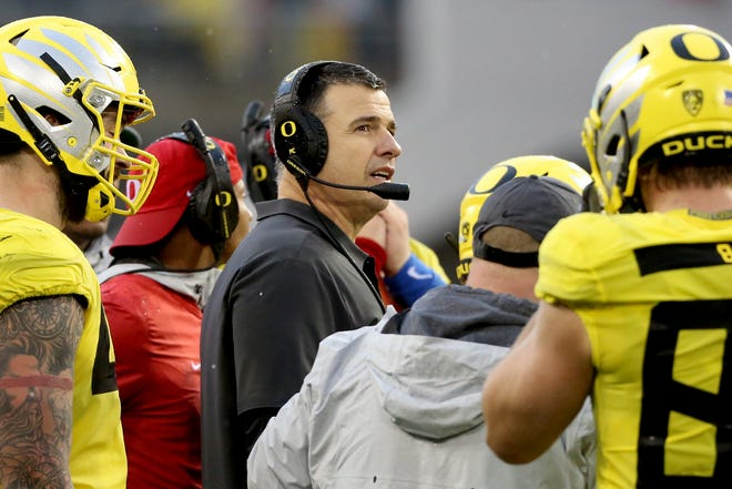 Oregon head coach Mario Cristobal talks to his team during a break in the Oregon vs. Oregon State Civil war football game at Oregon State University in Corvallis on Friday, Nov. 23, 2018. The Ducks won the game 55-15.