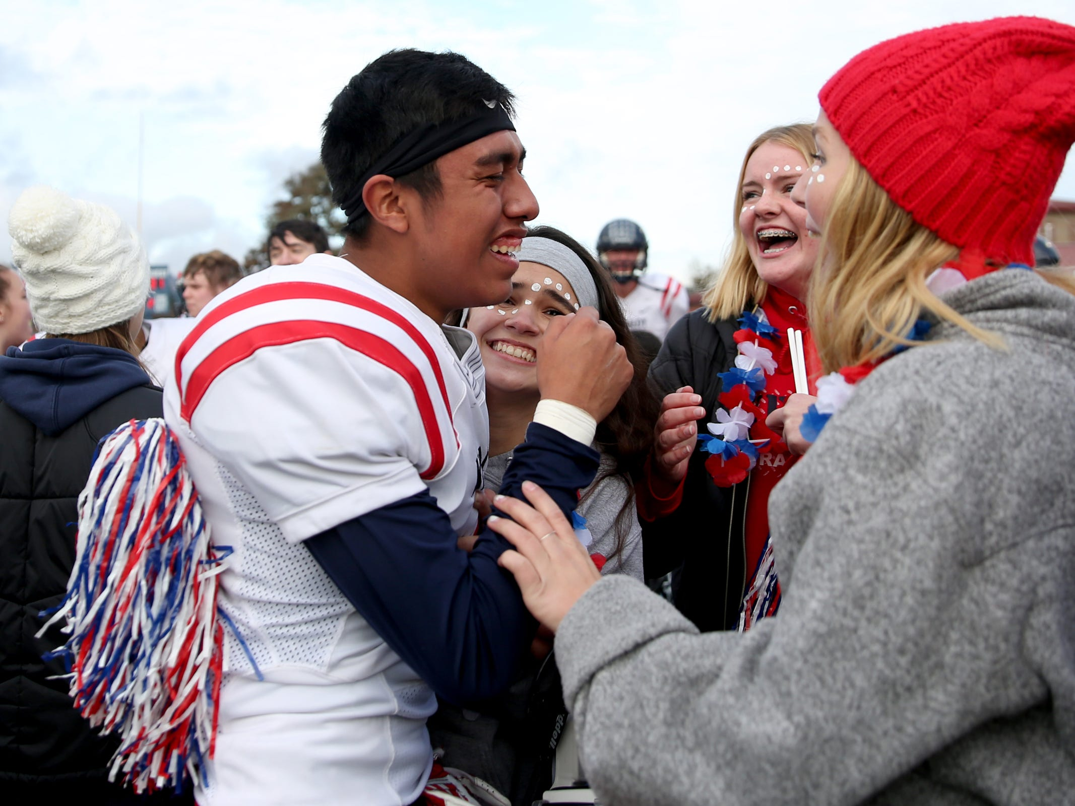 Kennedy's Brandon Salazar (6) celebrates with fans following the Kennedy vs. Santiam OSAA Class 2A state championship football game at Cottage Grove High School in Cottage Grove on Saturday, Nov. 24, 2018. Kennedy won the championship 31-20.