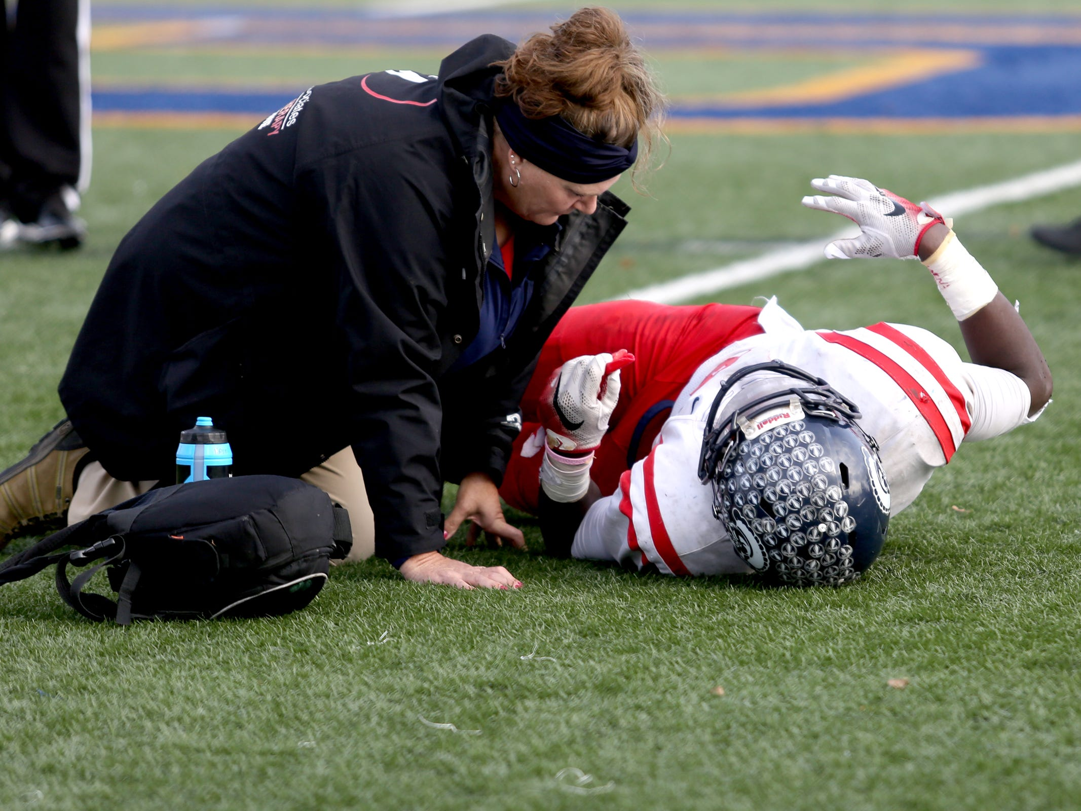 Kennedy's Emorej Lynk (8) is injured during the Kennedy vs. Santiam OSAA Class 2A state championship football game at Cottage Grove High School in Cottage Grove on Saturday, Nov. 24, 2018.
