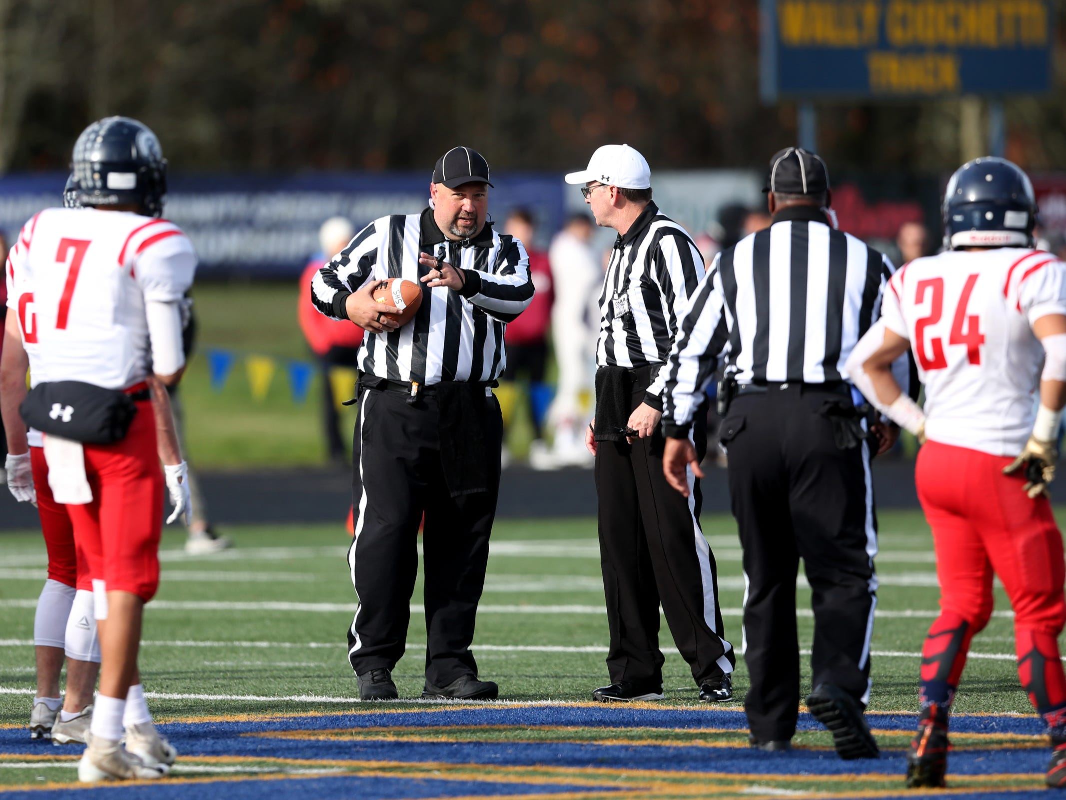 Referees discuss a play in the Kennedy vs. Santiam OSAA Class 2A state championship football game at Cottage Grove High School in Cottage Grove on Saturday, Nov. 24, 2018.