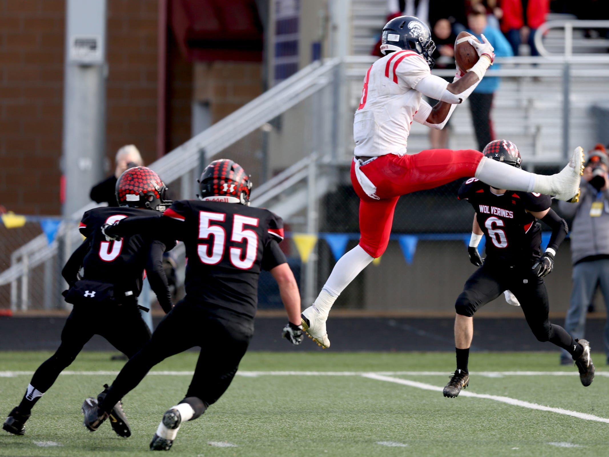 Kennedy's Emorej Lynk (8) leaps for a catch in the Kennedy vs. Santiam OSAA Class 2A state championship football game at Cottage Grove High School in Cottage Grove on Saturday, Nov. 24, 2018.
