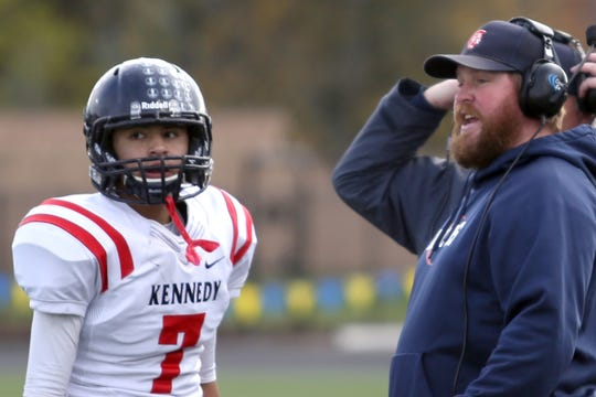 Kennedy head coach Joe Panuke talks with Angel De La Rosa (7) during the Kennedy vs. Santiam OSAA Class 2A state championship football game at Cottage Grove High School in Cottage Grove on Saturday, Nov. 24, 2018. Kennedy won the championship 31-20.