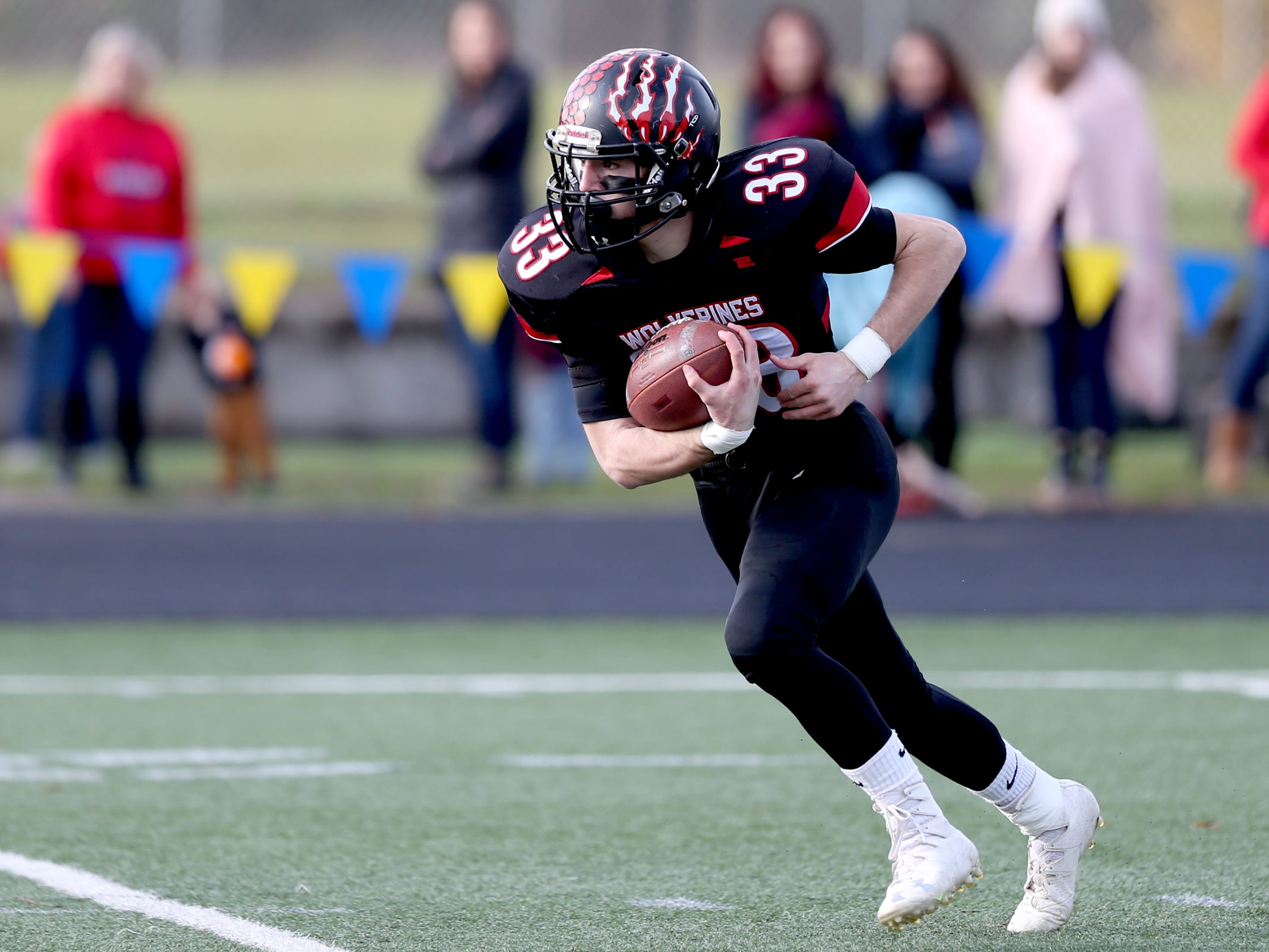 Santiam's Brody Davidson (33) rushes in the Kennedy vs. Santiam OSAA Class 2A state championship football game at Cottage Grove High School in Cottage Grove on Saturday, Nov. 24, 2018.
