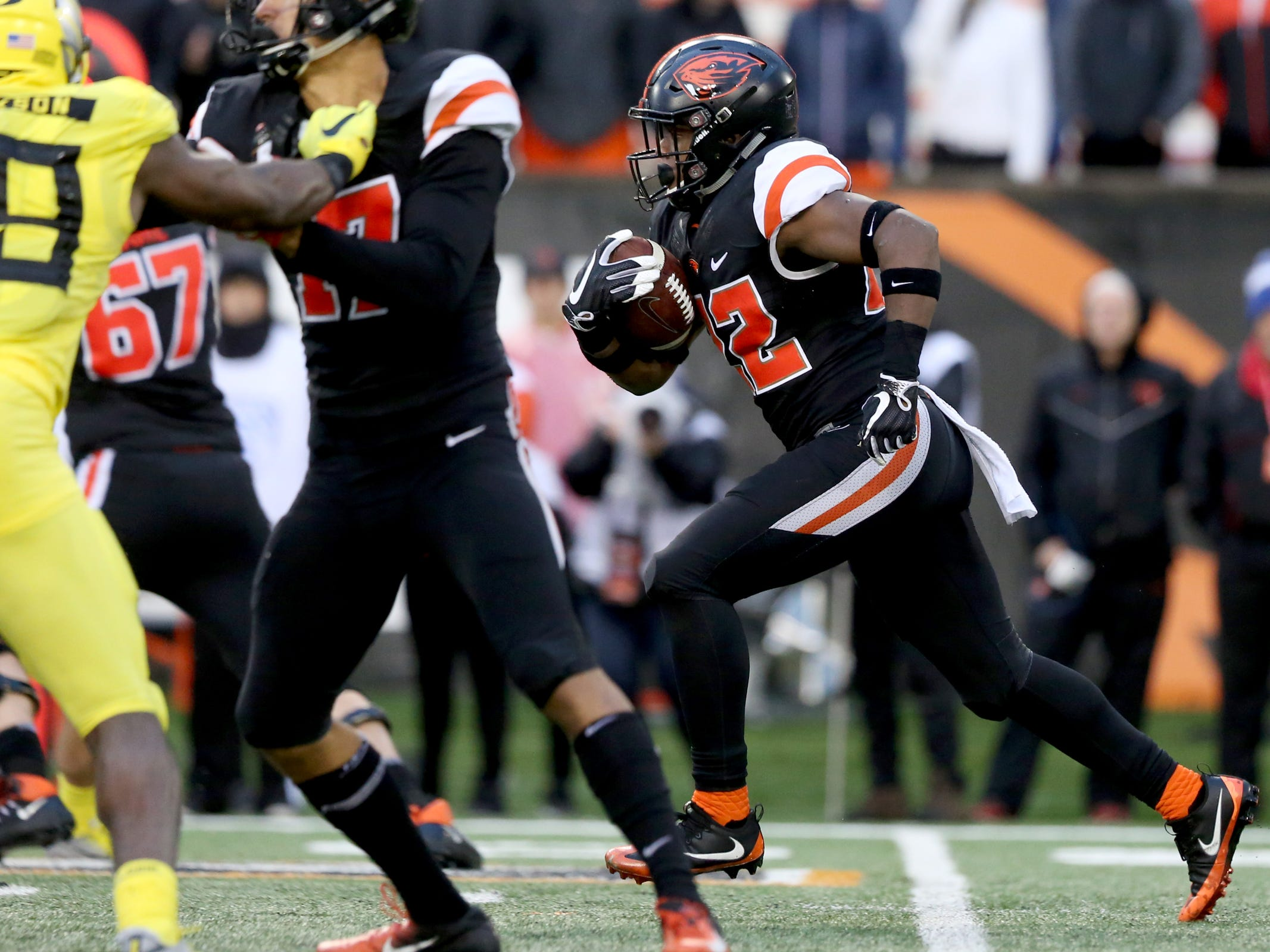 Oregon State's Jermar Jefferson (22) rushes down the middle in the Oregon vs. Oregon State Civil war football game at Oregon State University in Corvallis on Friday, Nov. 23, 2018. The Ducks won the game 55-15.