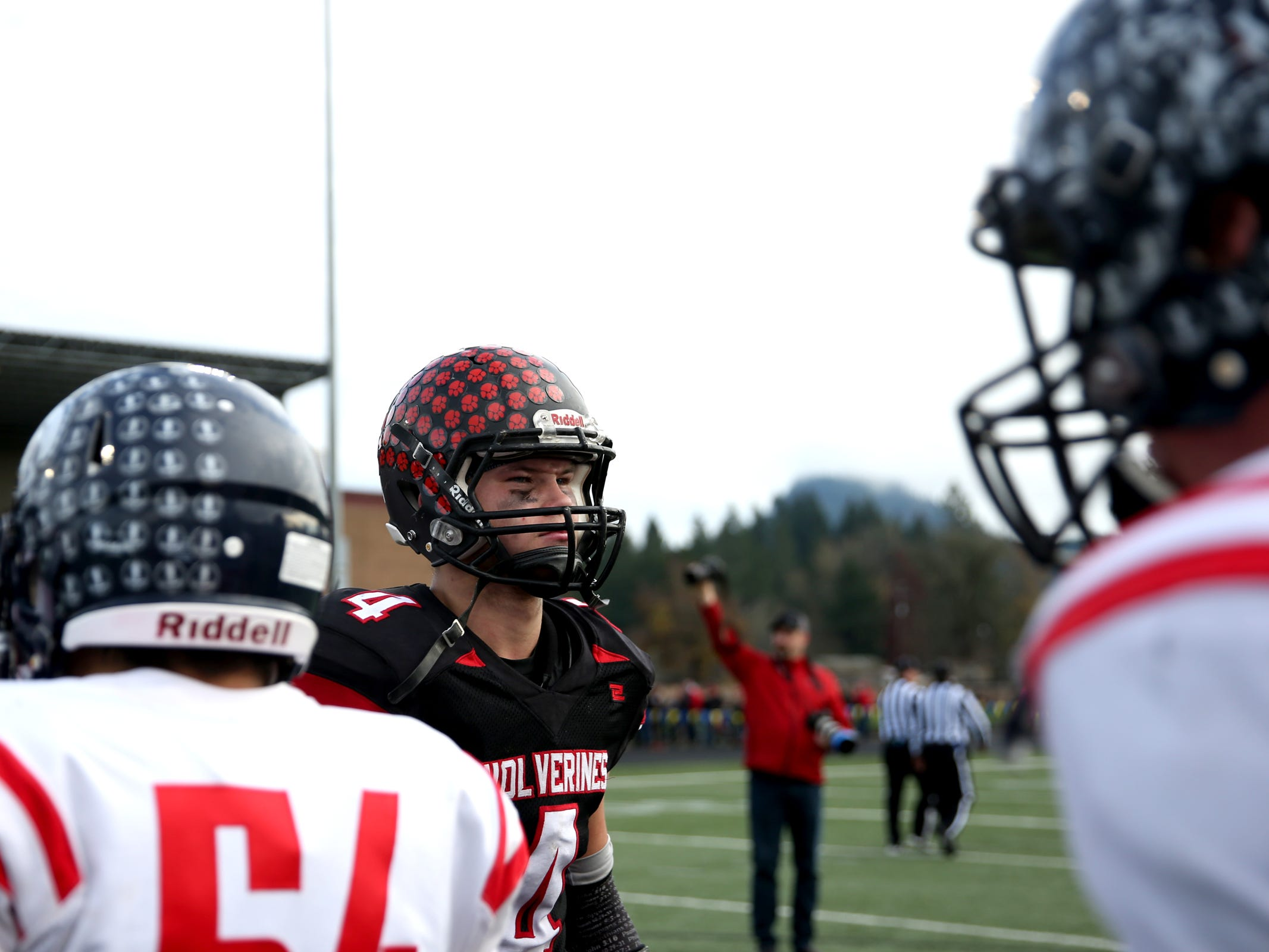 Santiam's Trevor Whitmire (4) walks off the field following the Kennedy vs. Santiam OSAA Class 2A state championship football game at Cottage Grove High School in Cottage Grove on Saturday, Nov. 24, 2018. Kennedy won the championship 31-20.