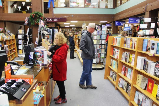 People shop at The Book Bin on Saturday, Nov. 24, in downtown Salem. The Book Bin participated in Small Business Saturday, which encourages shopping locally the day after Black Friday.