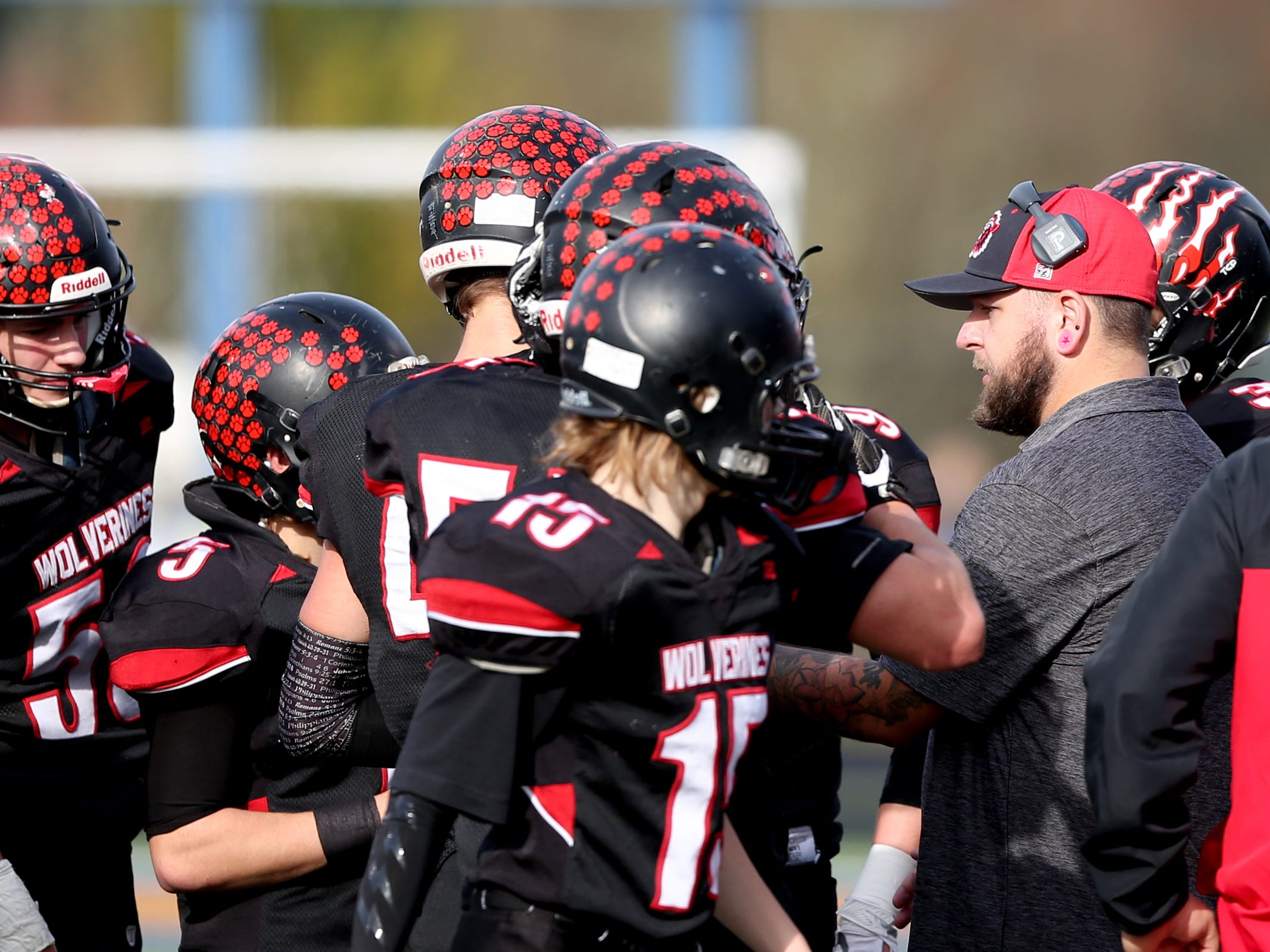 Santiam head coach Carl Rupp talks to his team during the Kennedy vs. Santiam OSAA Class 2A state championship football game at Cottage Grove High School in Cottage Grove on Saturday, Nov. 24, 2018.