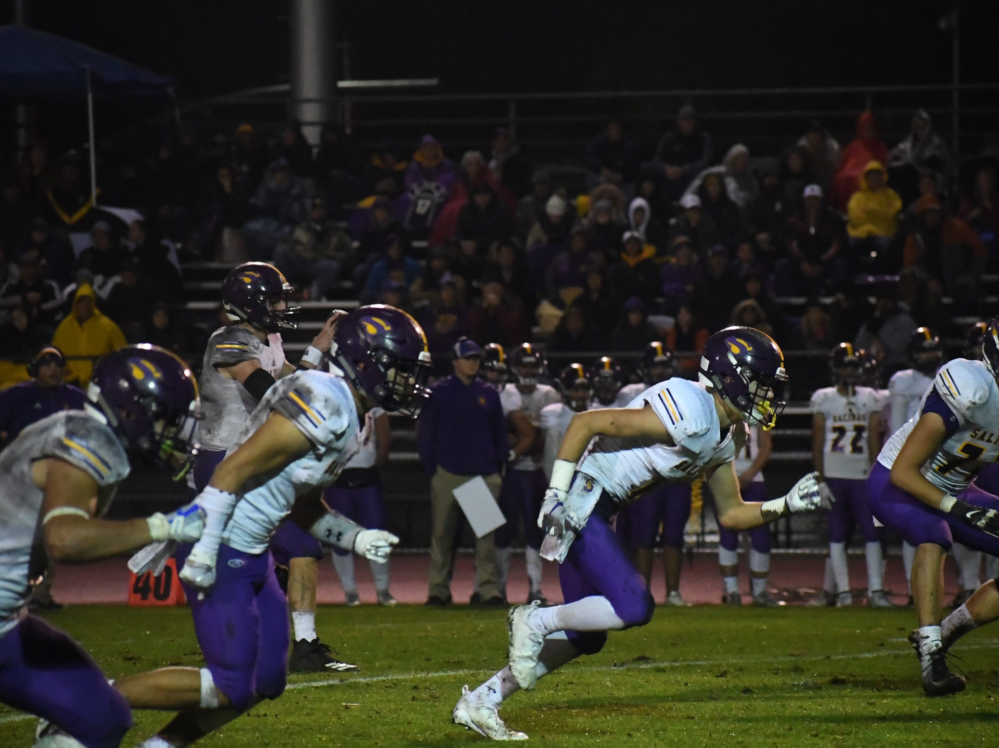 The Salinas wide receivers fire off after the snap.