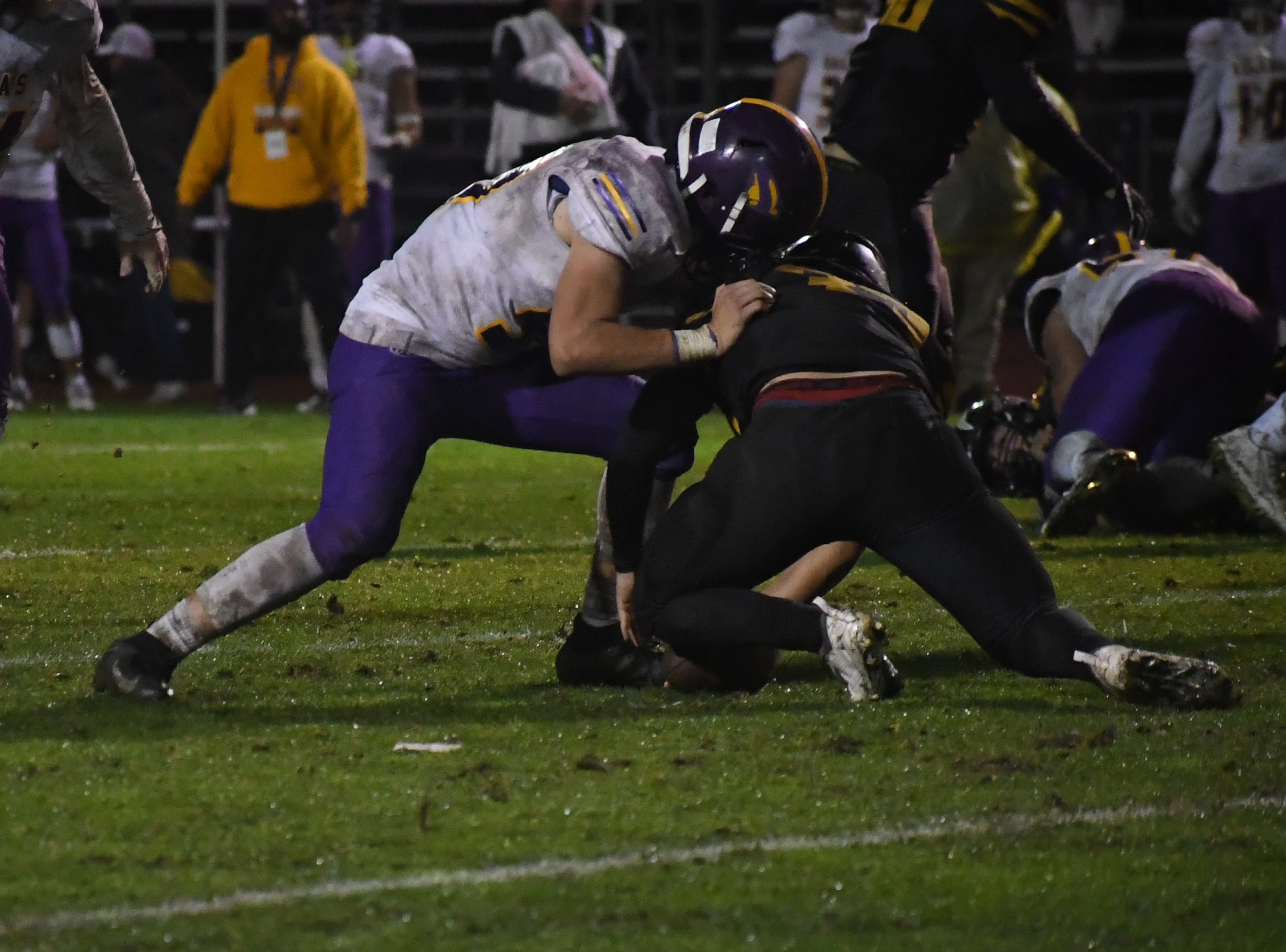 Linebacker Kyle Lawson (99) wrestles for a fumble.