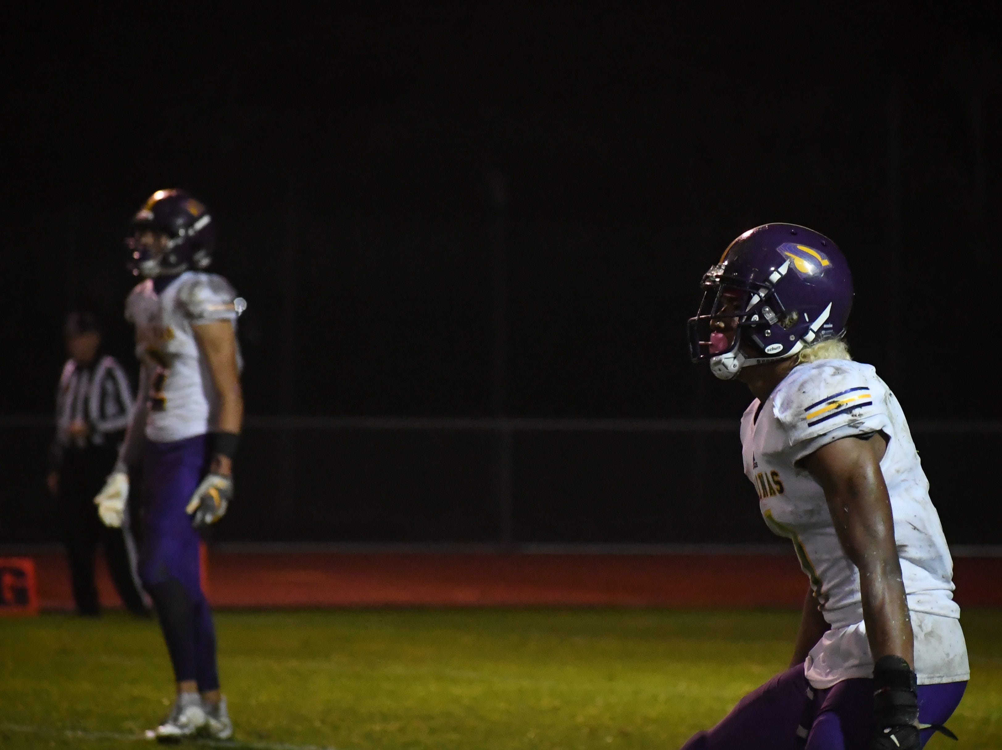 Wide receivers Poe Gaskins (right) and Zachary Robison (left) wait for a kickoff.