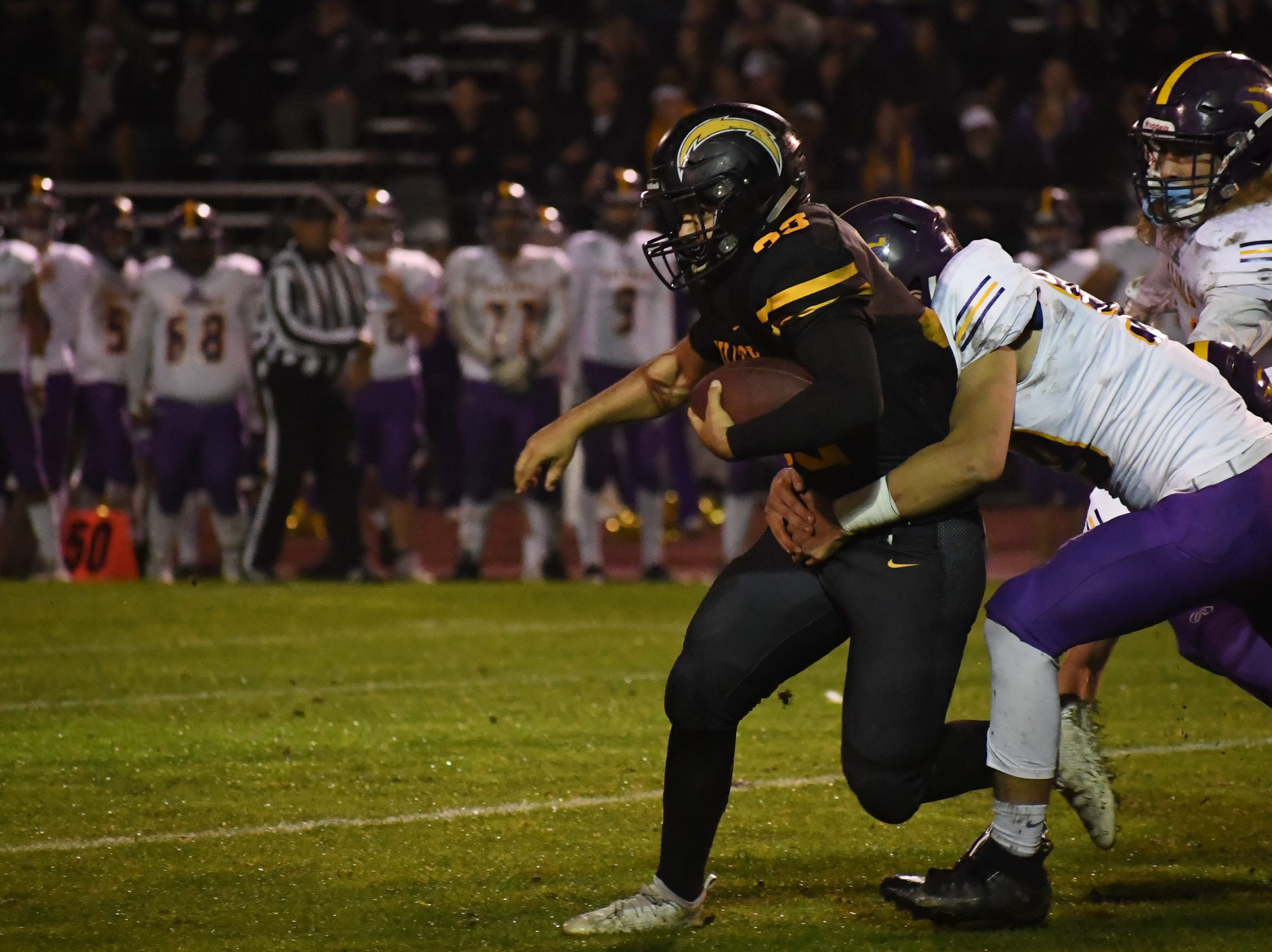 Defensive lineman Zachary Datan (50) chases down a Wilcox running back.