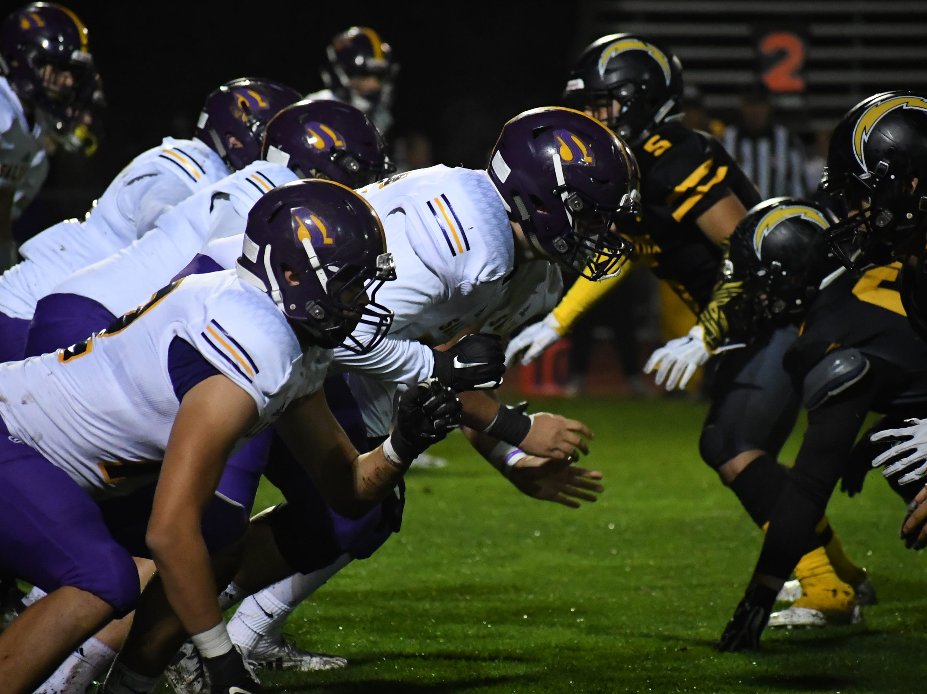 The Salinas offensive line fires off during their opening drive.