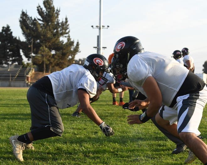 The Gonzales High Spartans won't take the field until December at the earliest. In the meantime, Spartan coaches have been laid off.
