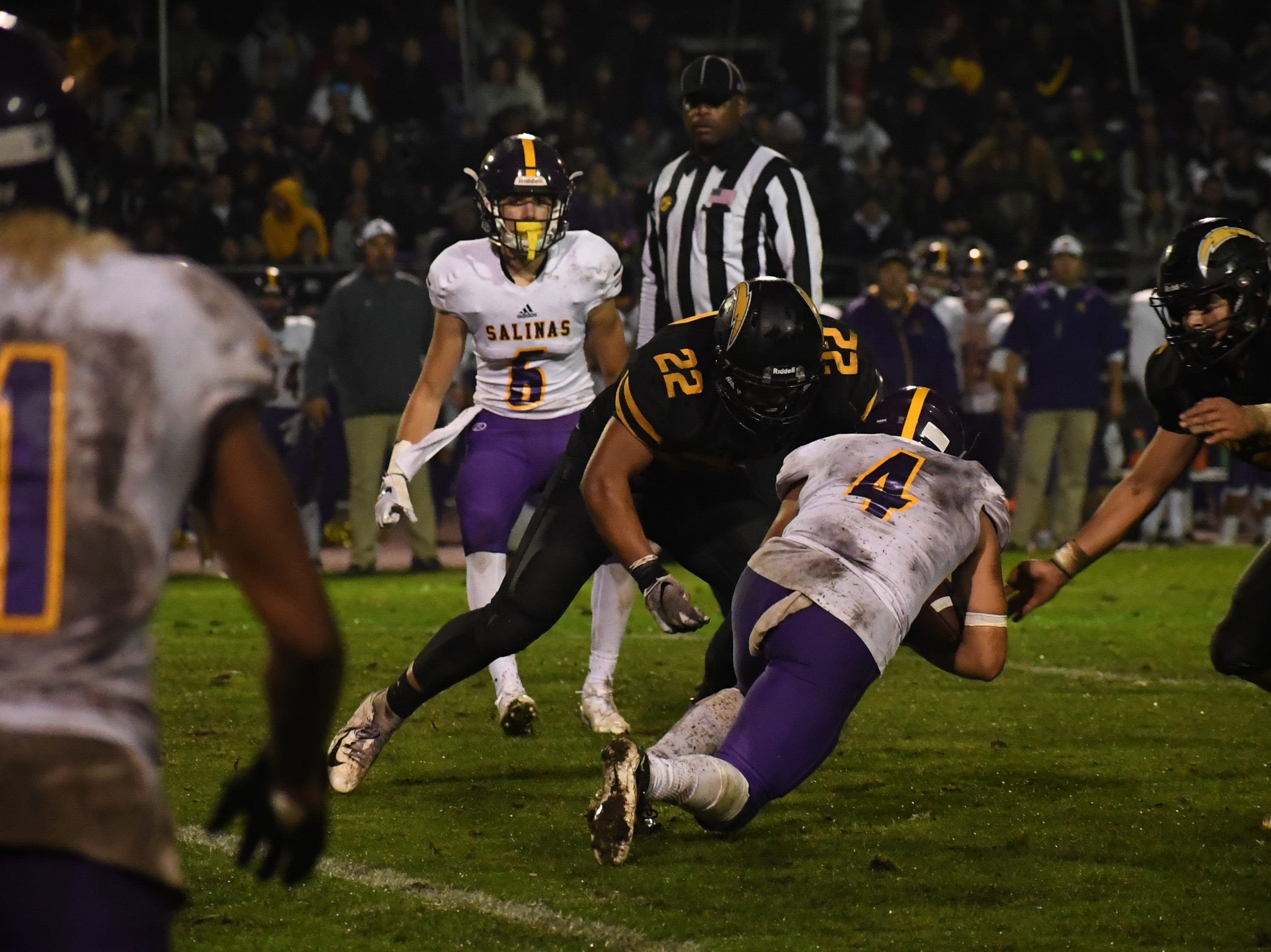 Wide receiver Ivan Curiel (4) dives forward for a first down.