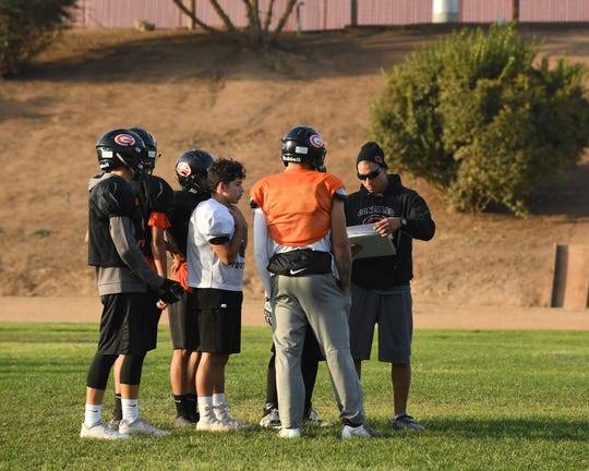 Gonzales football coach Art Berlanga (far right) organized the trip to the Salinas Valley Correctional Training Facility with 18 students, many of who are Spartan football players.