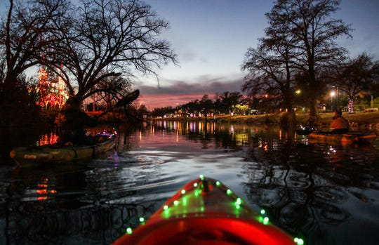People paddle through the lights in 2017 on the Concho River.