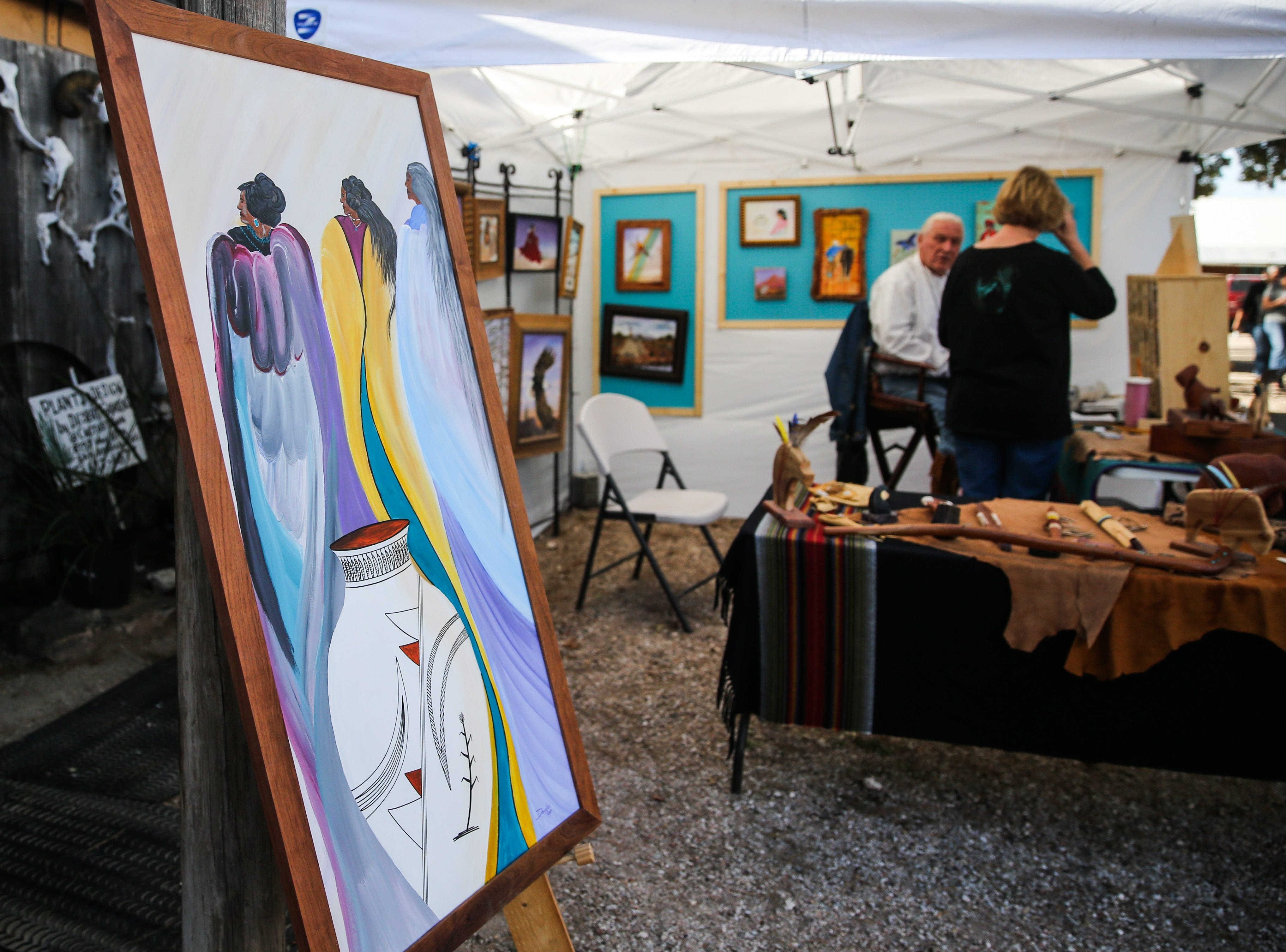 Paintings are on display at a booth during the Thanksgiving Open House Friday, Nov. 23, 2018, at the Chicken Farm Art Center.