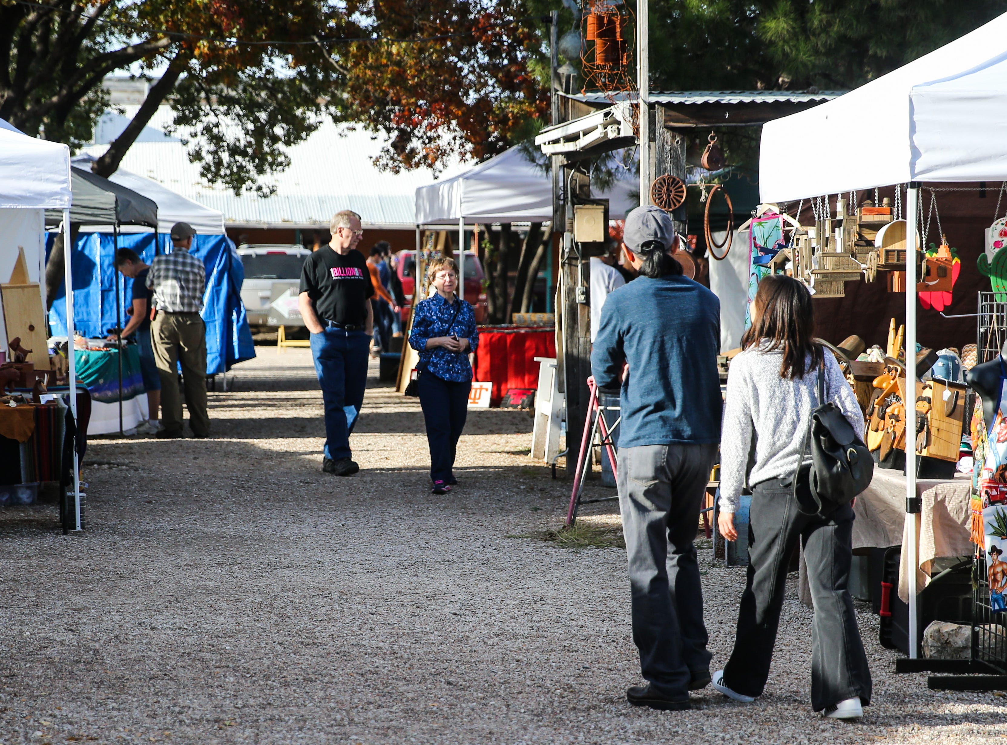 Visitors walk around the booths during the Thanksgiving Open House Friday, Nov. 23, 2018, at the Chicken Farm Art Center.