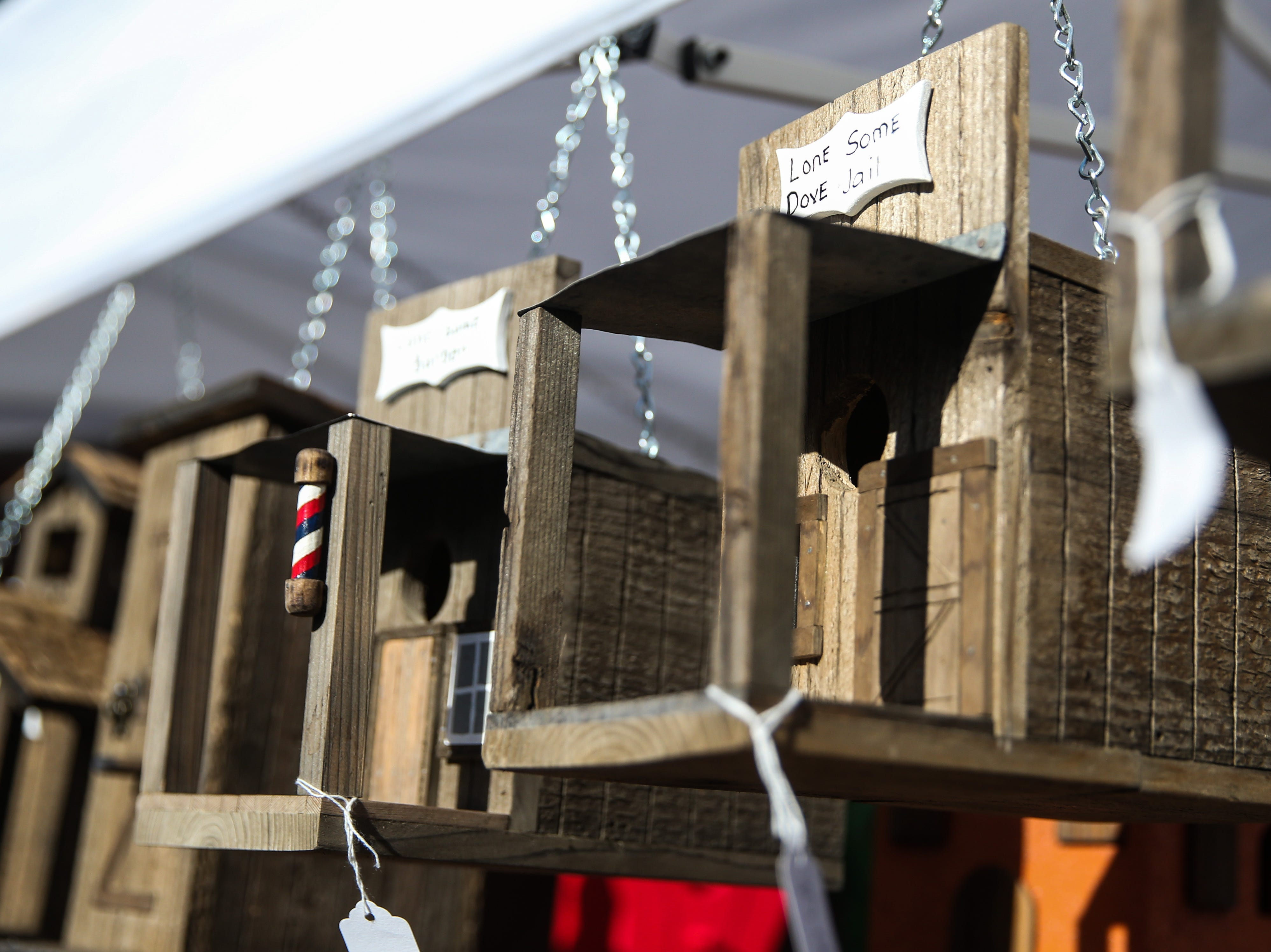 Bird houses are on display at a booth during the Thanksgiving Open House Friday, Nov. 23, 2018, at the Chicken Farm Art Center.