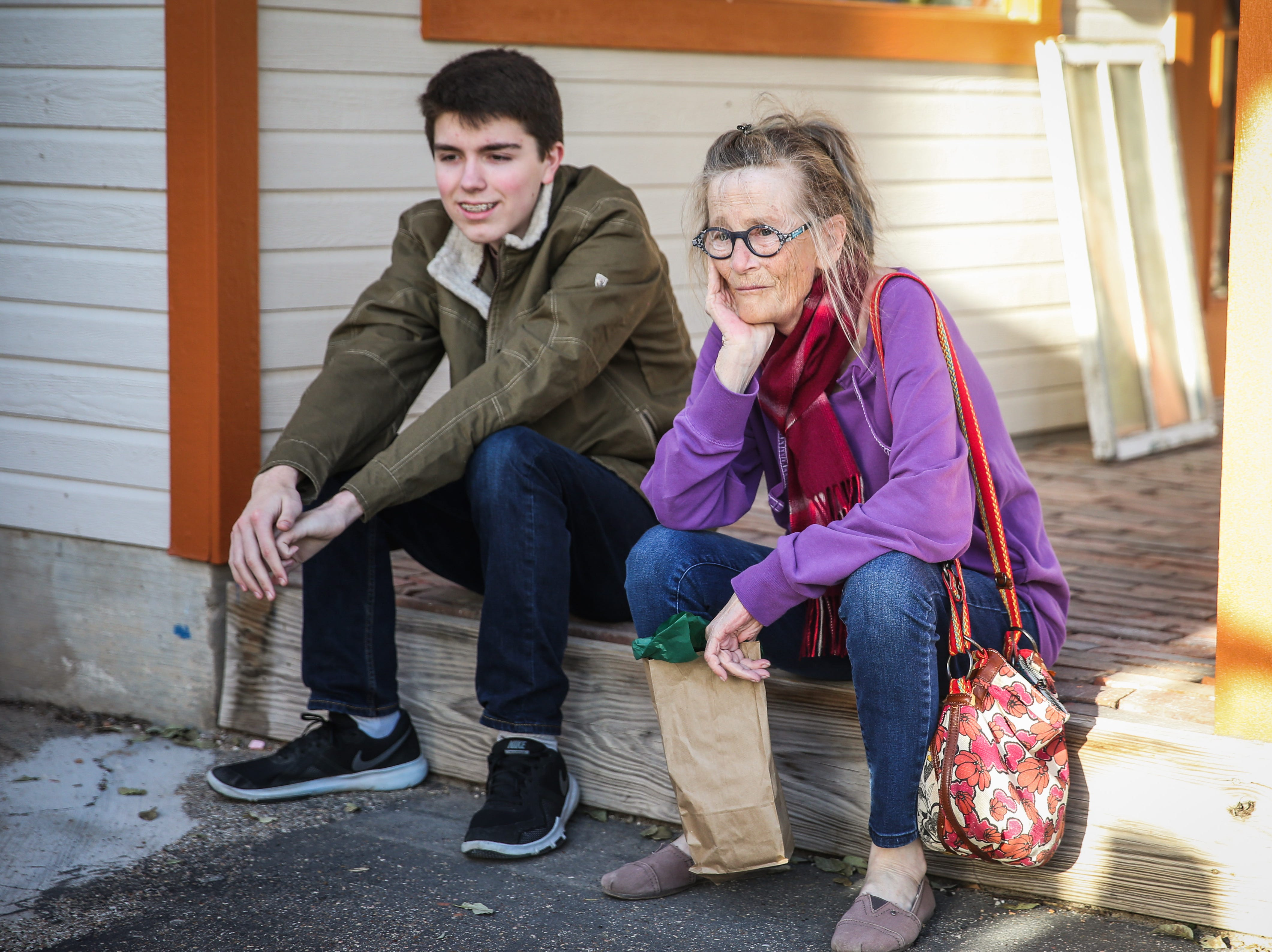 Hayden Best, 16, and Kathleen Wilkinson rest while shopping during the Thanksgiving Open House Friday, Nov. 23, 2018, at the Chicken Farm Art Center.