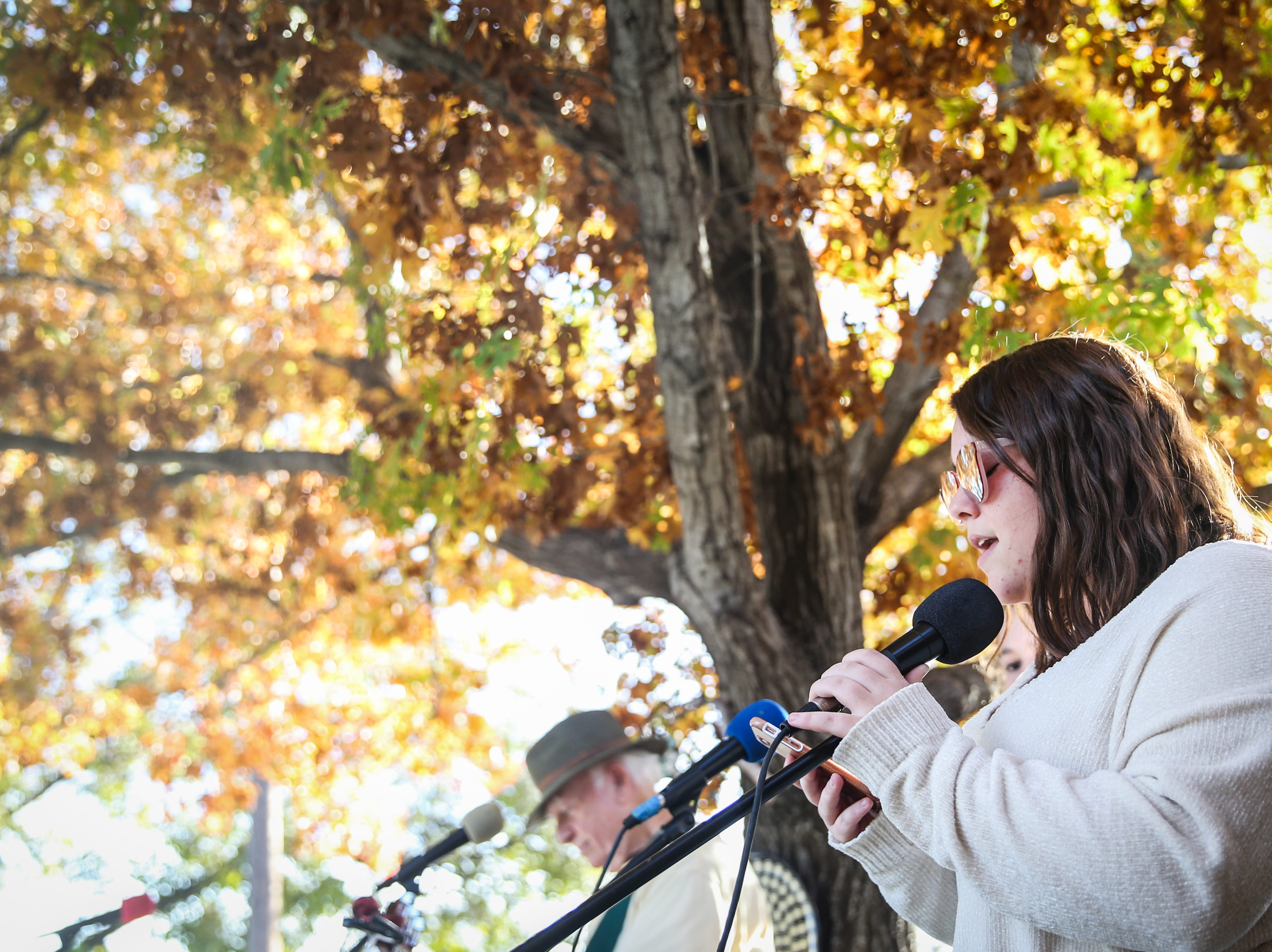 Jordan Maxheimer sings in the courtyard during the Thanksgiving Open House Friday, Nov. 23, 2018, at the Chicken Farm Art Center.