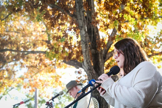 Jordan Maxheimer sings in the courtyard during the Thanksgiving Open House Friday, Nov. 23, 2018, at the Chicken Farm Art Center.
