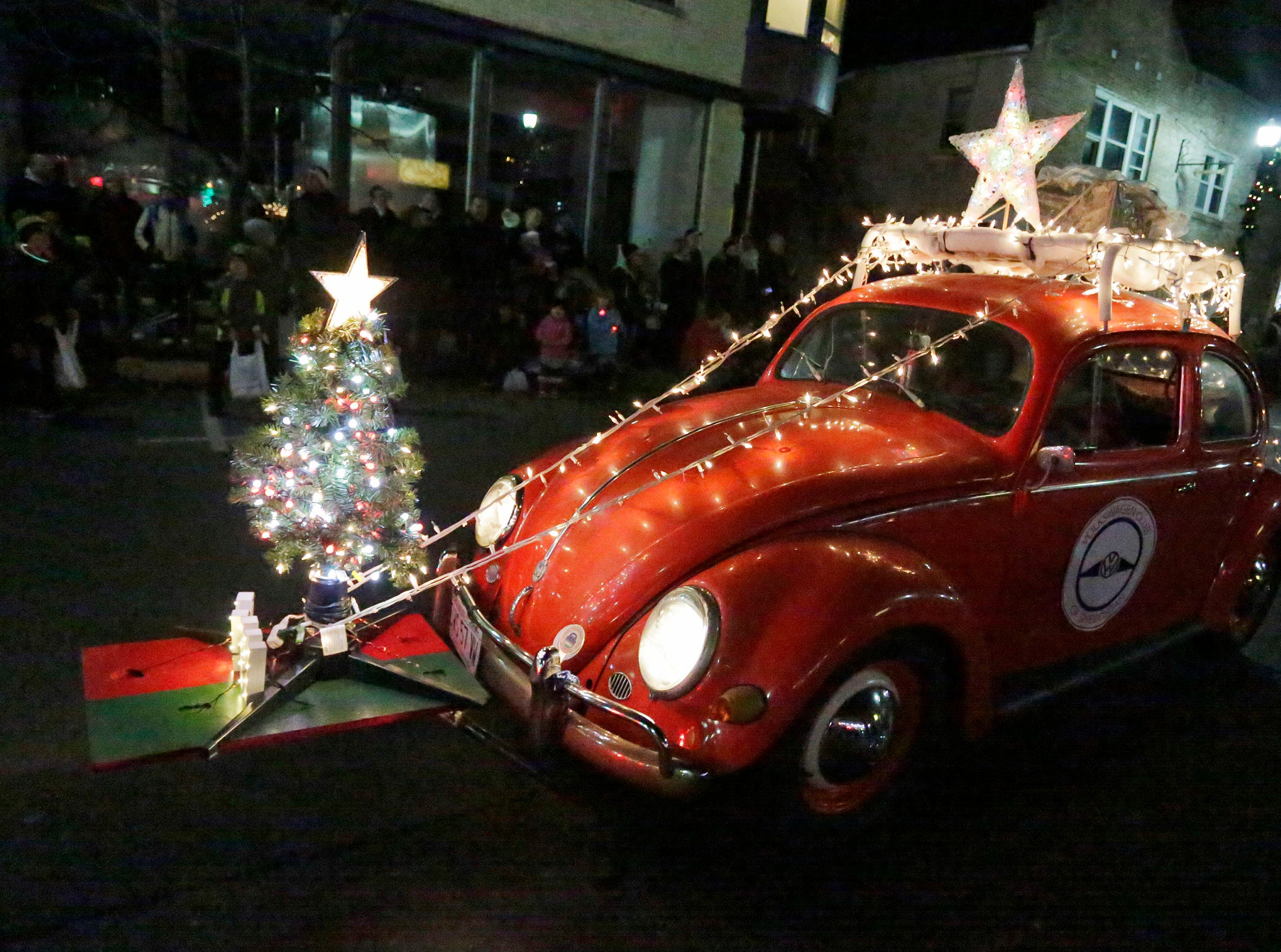 David Weinhold of Sheboygan Falls drives his well illuminated Volkswagen Beetle in the Plymouth Christmas Parade, Friday, November 23, 2018, in Plymouth, Wis.