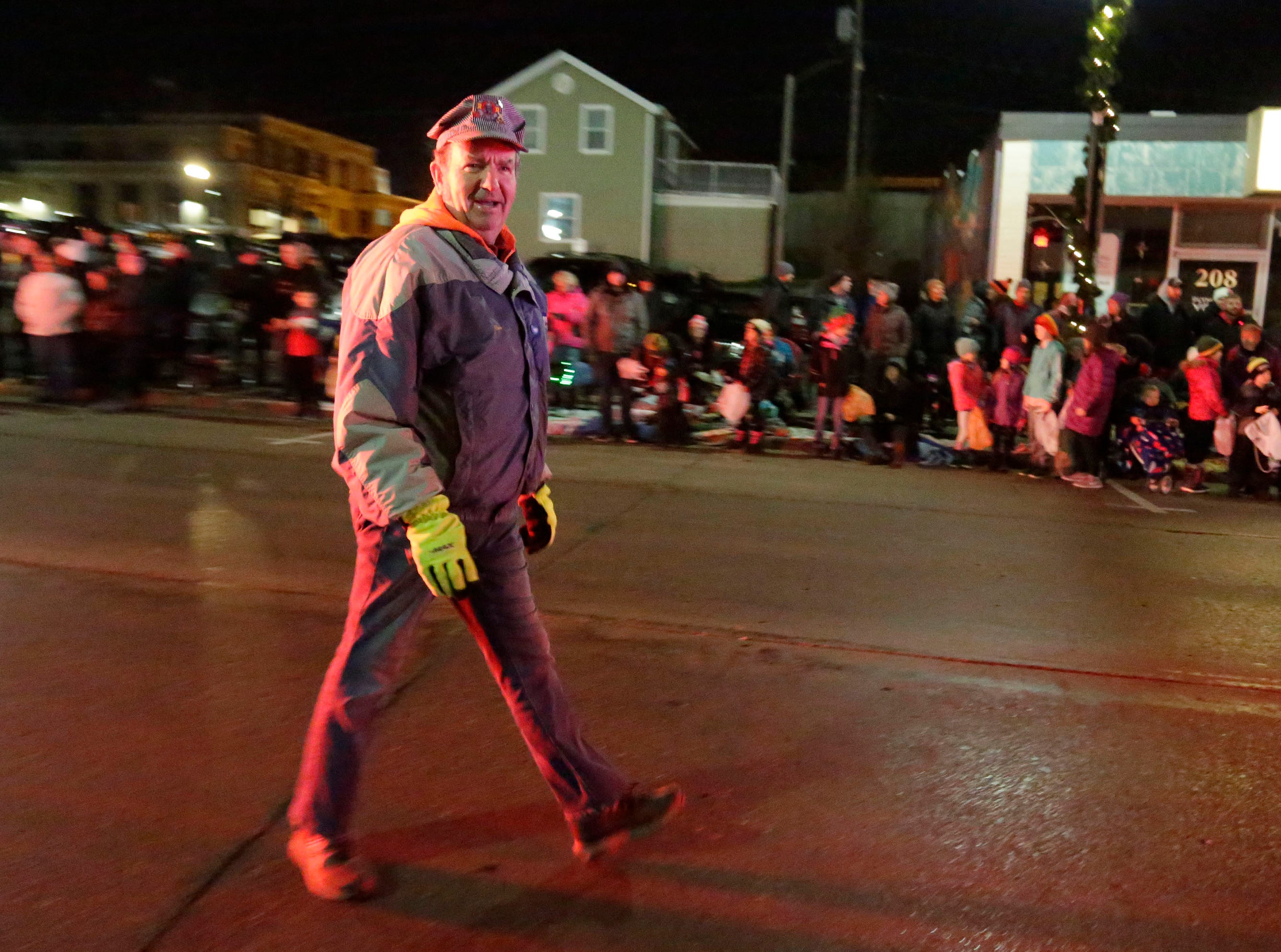 Plymouth Mayor Don Pohlman dressed like a locomotive operator in the Plymouth Christmas Parade, Friday, November 23, 2018, in Plymouth, Wis.
