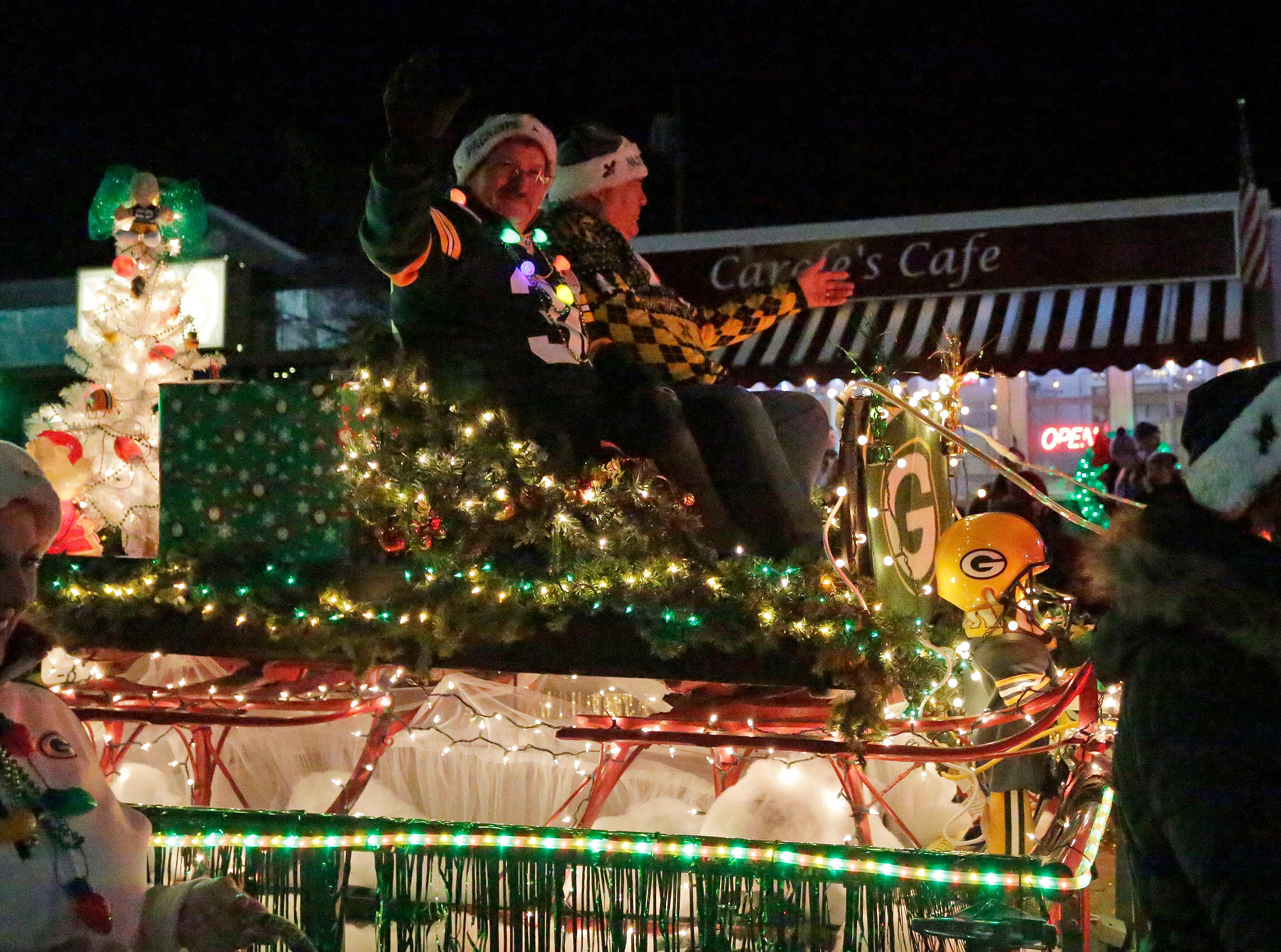 A dream of a Green Bay Packer Santa Claus at the Plymouth Christmas Parade, Friday, November 23, 2018, in Plymouth, Wis.