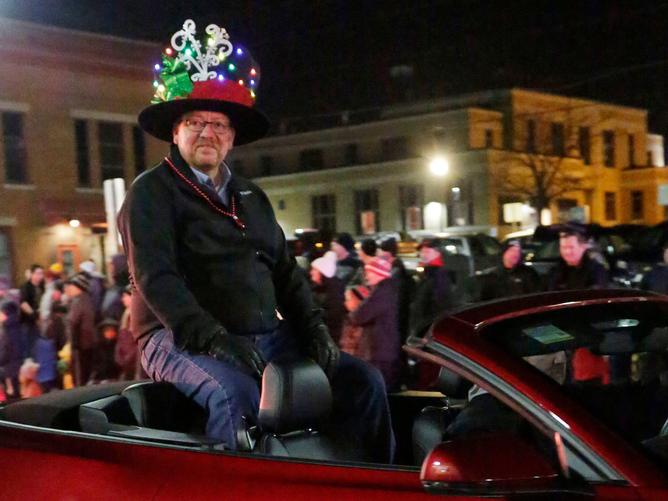 Grand Marshall Todd Neils rides in the Plymouth Christmas Parade, Friday, November 23, 2018, in Plymouth, Wis.
