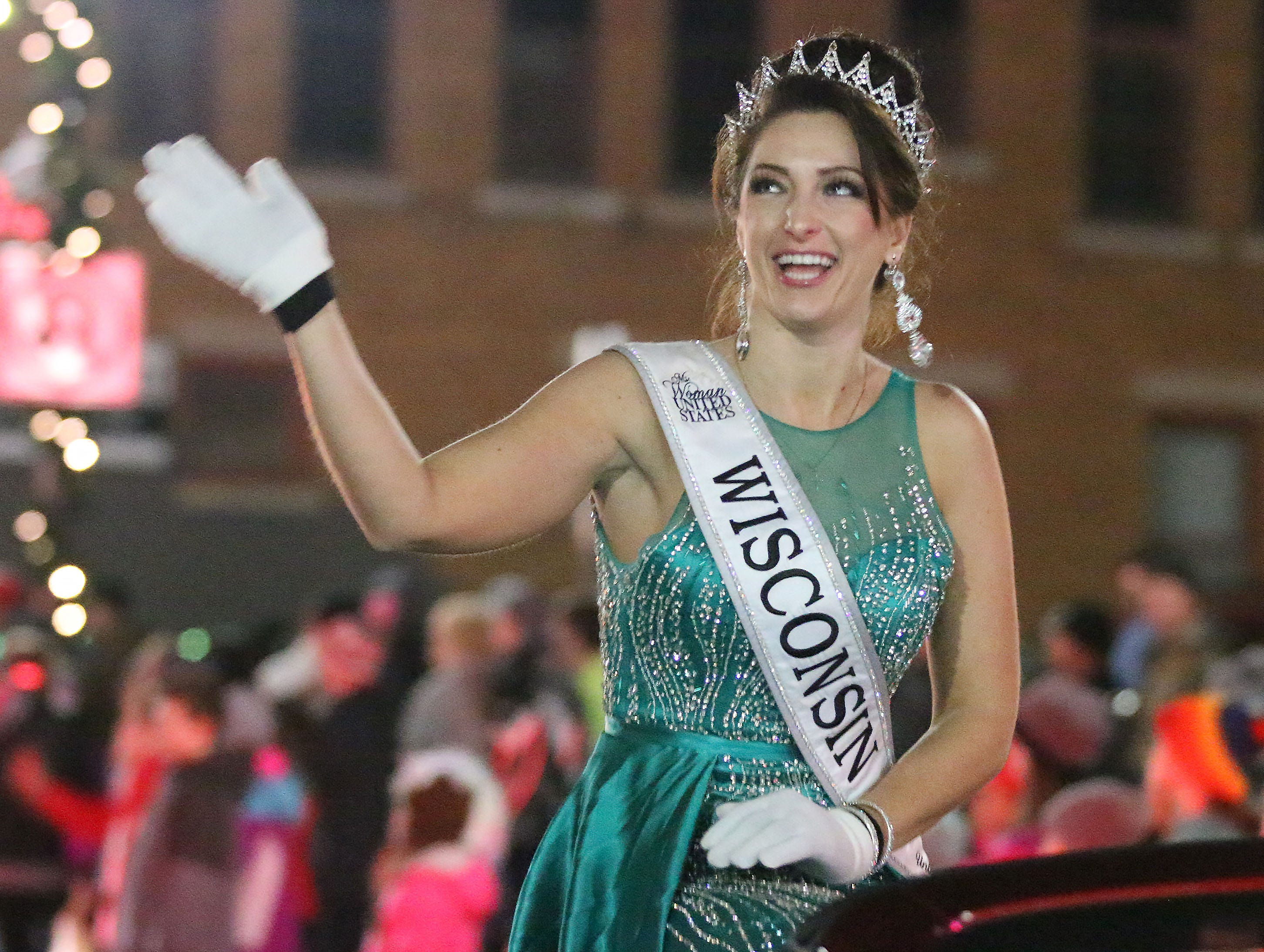 Ms. Woman United States Wisconsin Katherin Rose waves to the crowds at Plymouth Christmas Parade, Friday, November 23, 2018, in Plymouth, Wis.