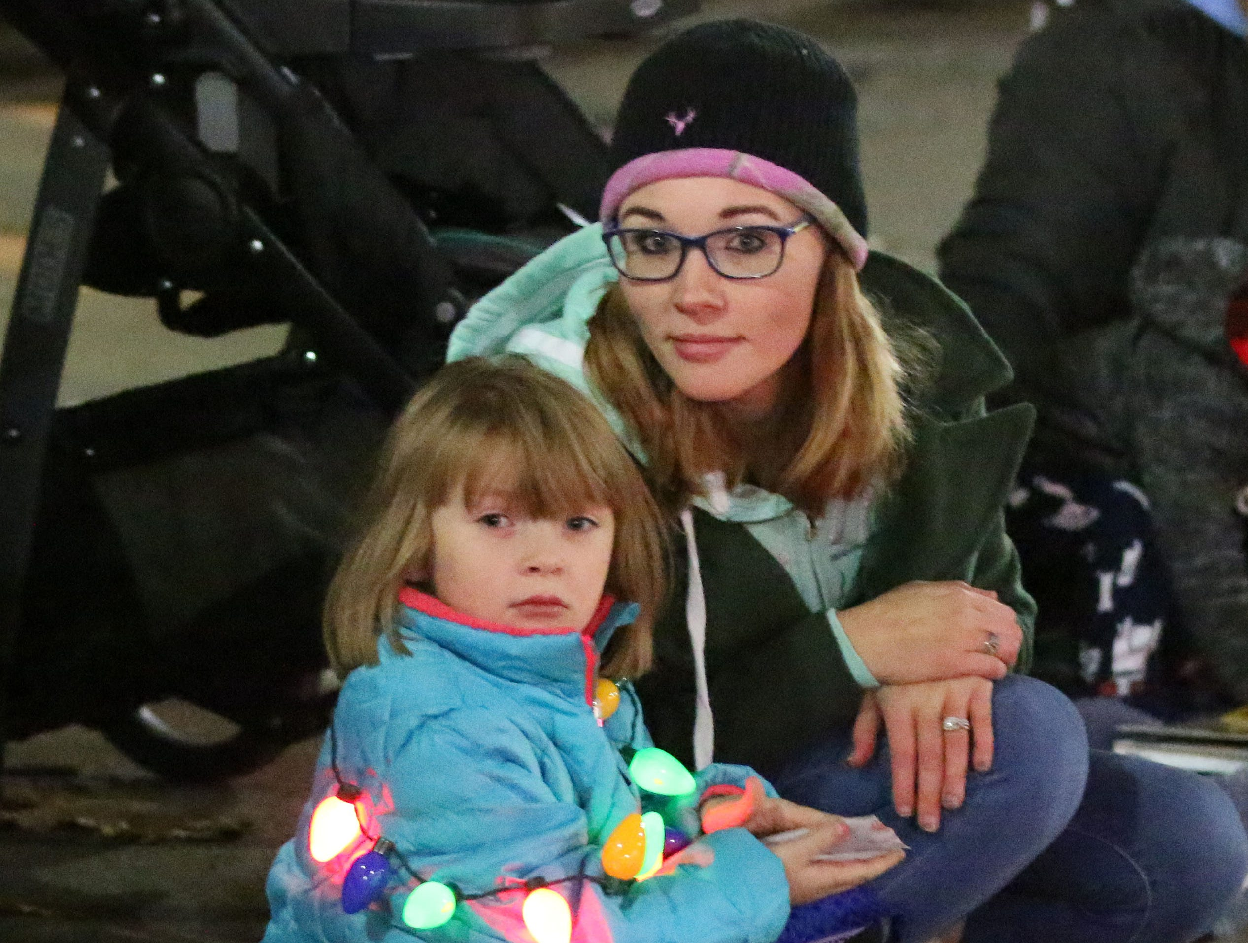 Rylee Lecher, 5, and her mom Jamie Diekow wait for the Plymouth Christmas Parade to begin, Friday, November 23, 2018, in Plymouth, Wis.