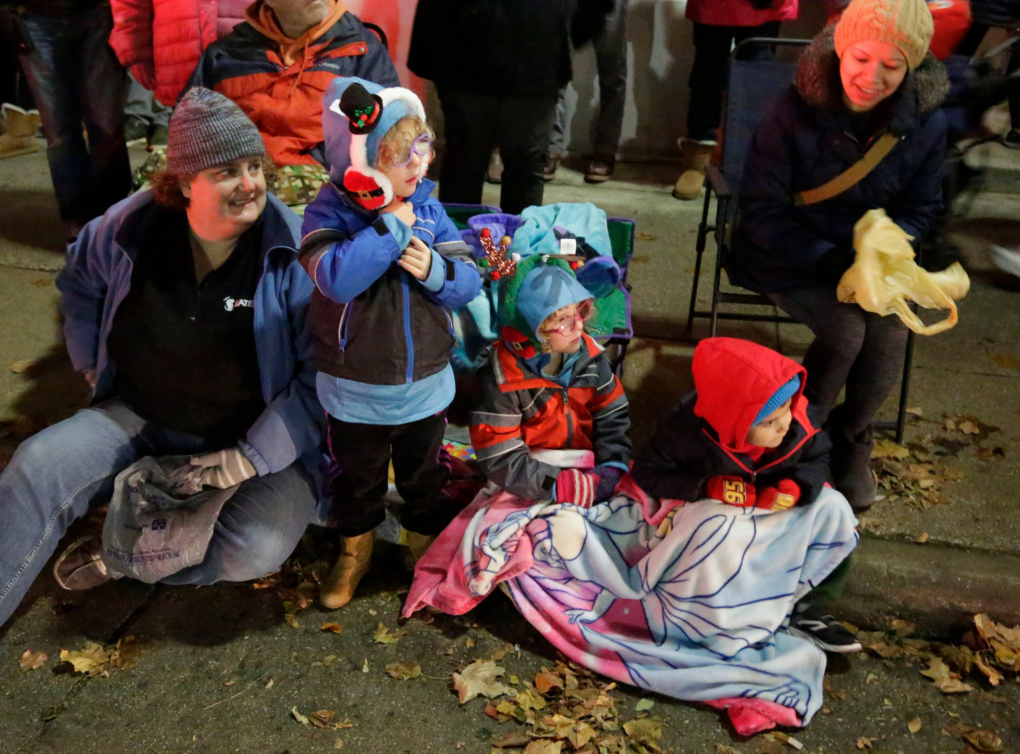 People of all ages await the start of the  Plymouth Christmas Parade, Friday, November 23, 2018, in Plymouth, Wis.