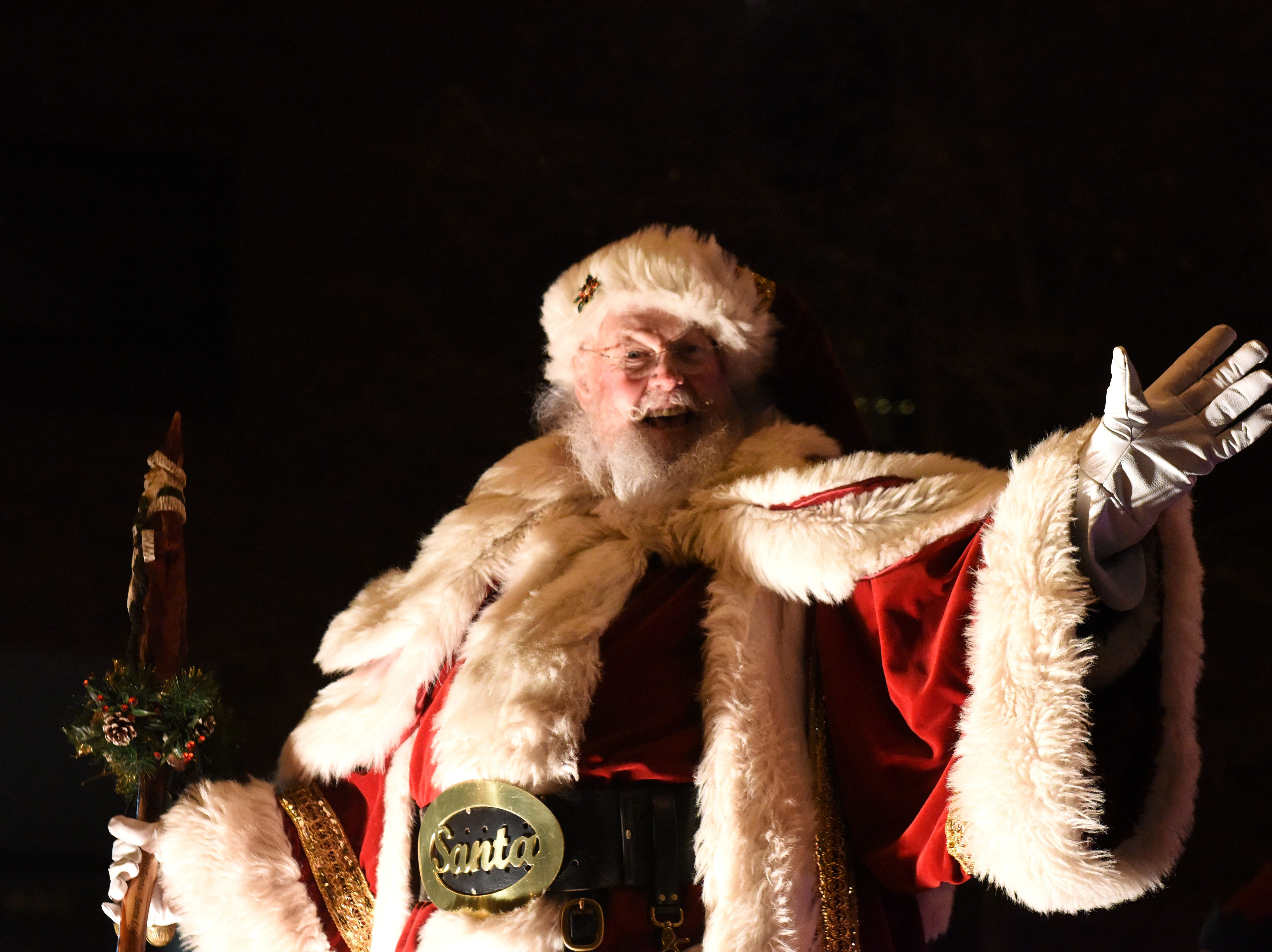 Santa waves to the crowd during the annual Parade of Lights in downtown Sioux Falls, S.D., Friday, Nov. 23, 2018.